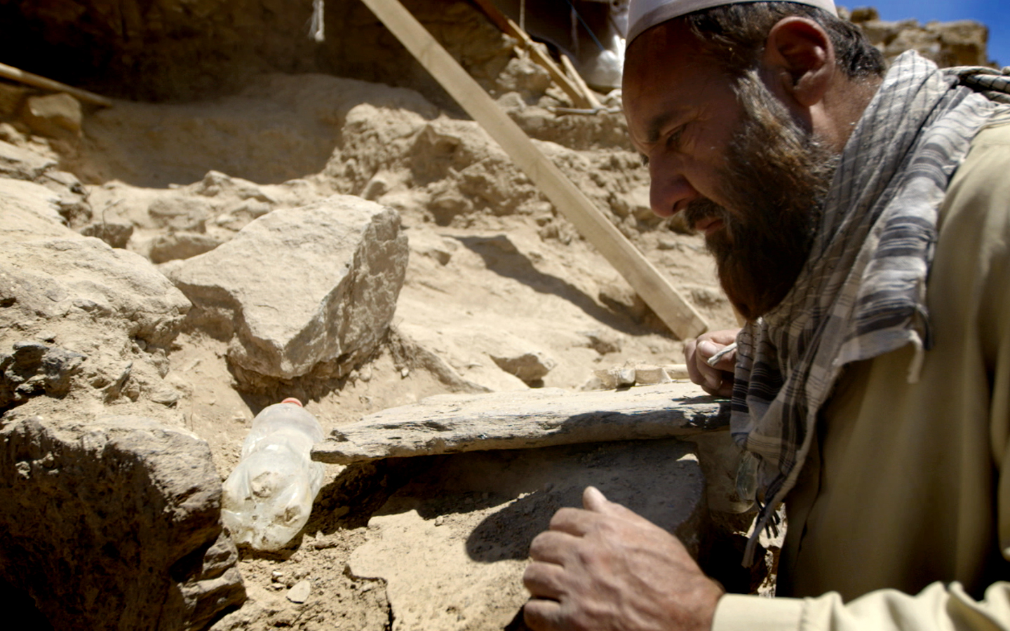 One of the Mes Aynak archaeologists inspecting a newly-discovered structure.