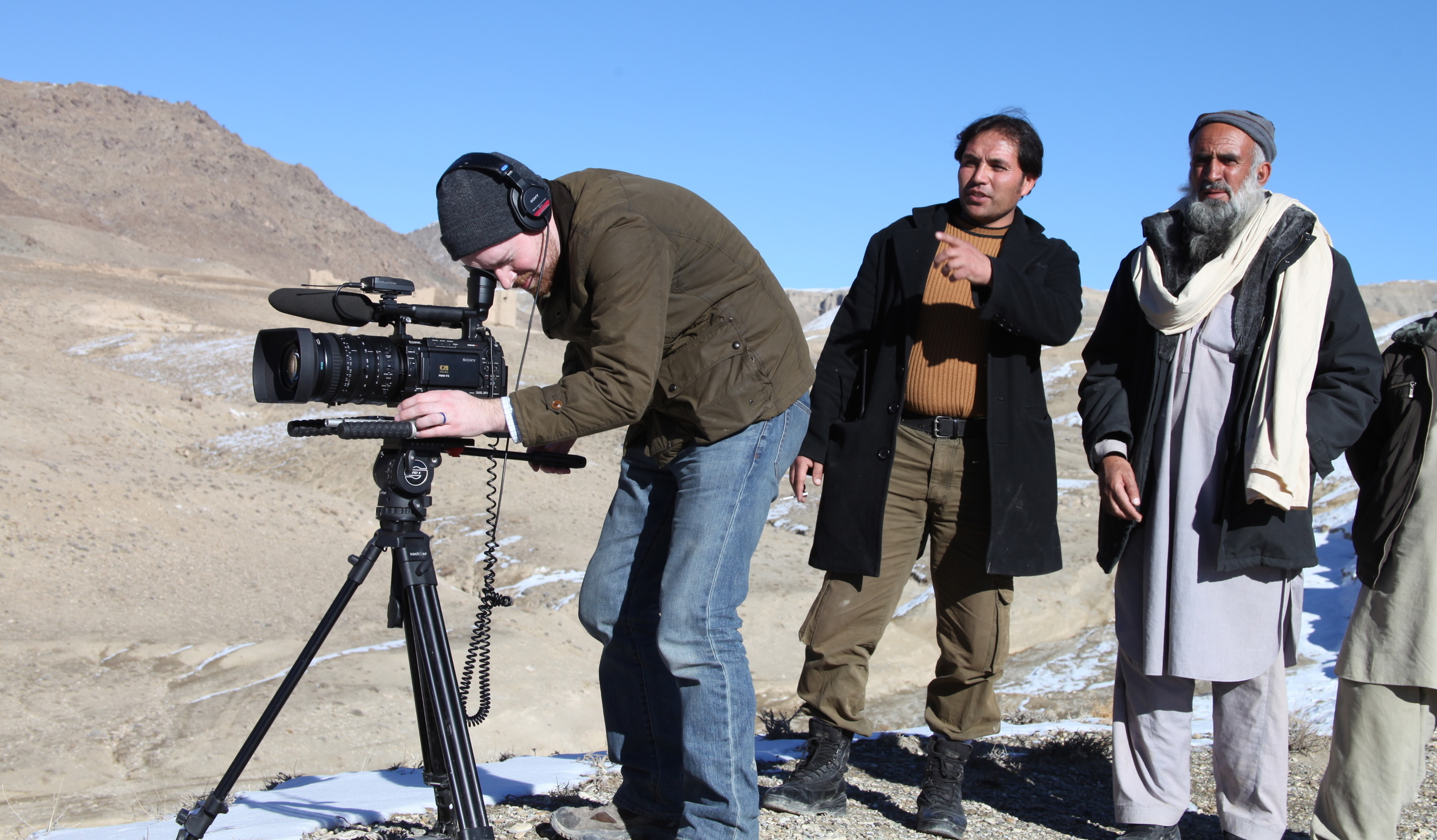 Brent E. Huffman and Qadir Temori, filming at one of the many villages that will be destroyed due to the mining.