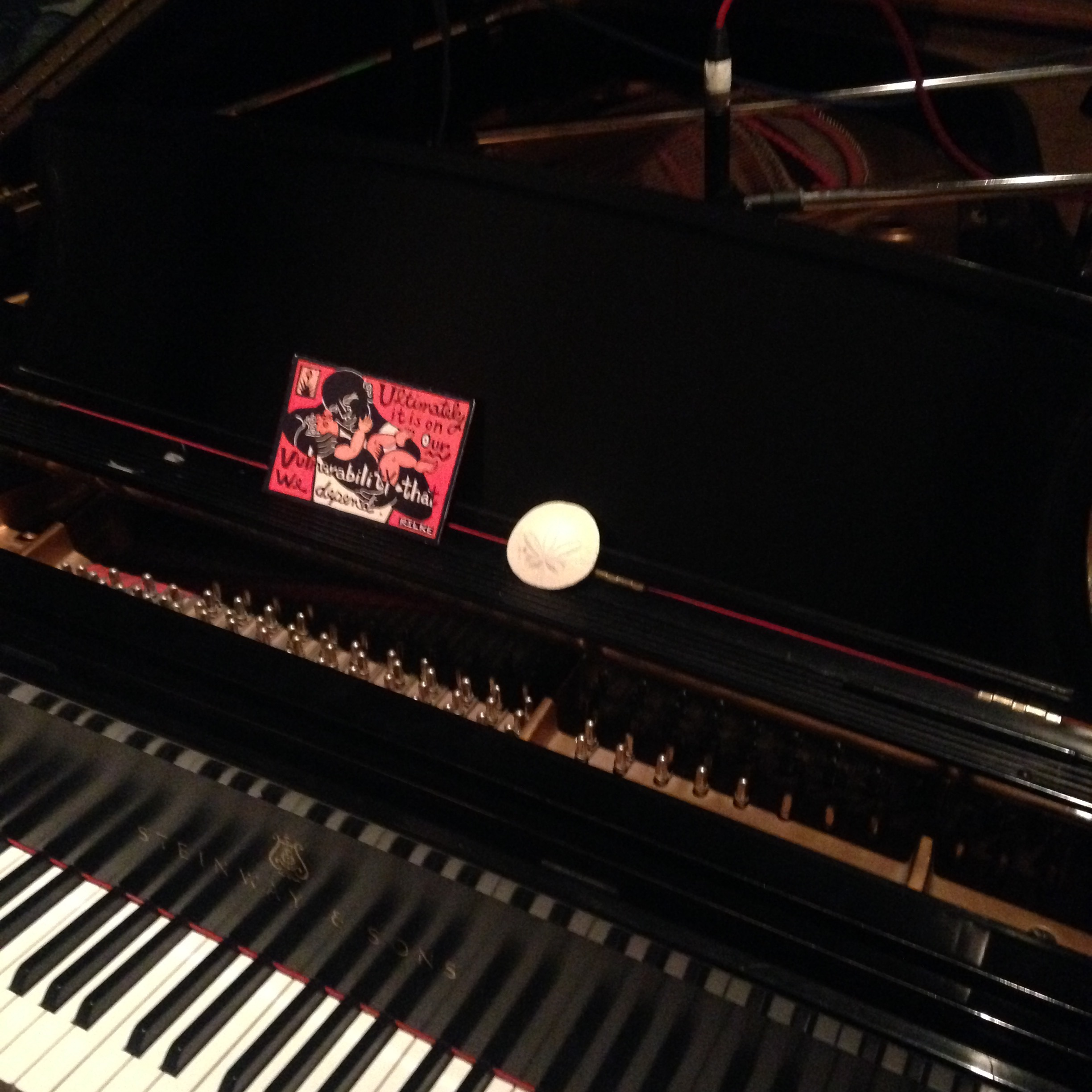 """I brought with me two of the talismans that sit at my regular practice space: a sand dollar, which is a symbol for me of my call to be a musician, and this Rilke card reminding me """"Ultimately it is on our vulnerability that we depend."""""""