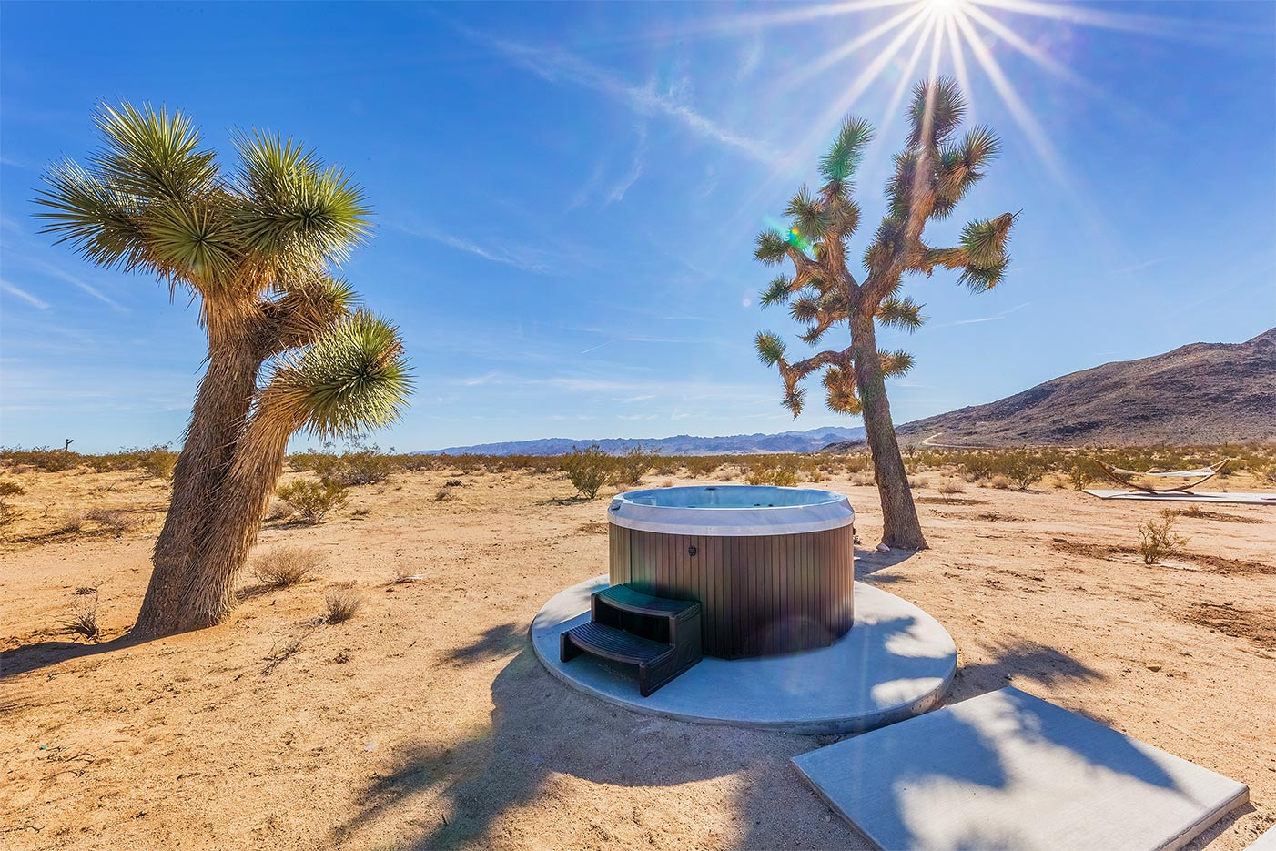 """Hot Tubs - Hot tubs are at the top of the list of features  that can demonstrably boost  revenue at vacation rentals. We install all makes and models and we are expert at knowing the best places to install them to ensure the biggest """"wow"""" factor.  And we do it all — including installing concrete pads and providing  the necessary wiring and plumbing."""