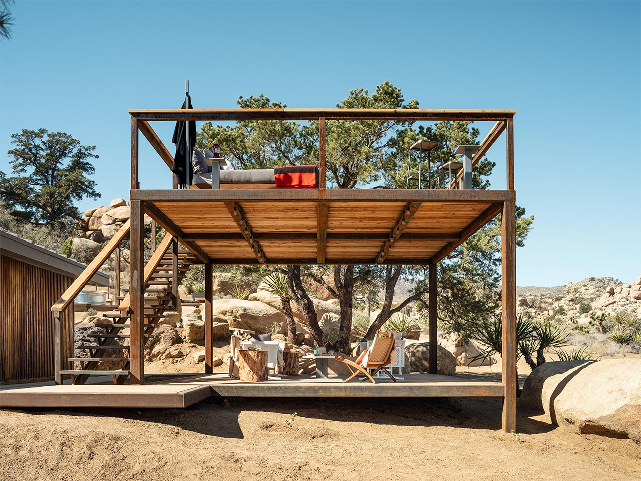 Elevated Observation / Sleeping Platforms - Sometimes the only way to take in the fully majesty of our sprawling desert is to go up a little in elevation — to remove as many visual barriers as possible. At the same time there are those of us who think there is no more magical way to fall asleep other than under a blanket of stars.Our elevated observation / sleeping platforms are designed to meet both requirements. We build them with sturdy, site-welded tube steel frames and then add redwood or ipe decking.These platforms come with a major bonus — the elevated deck creates a naturally shaded lower area perfectly suited for a summer sun-protected second deck. Two decks for the price of one!