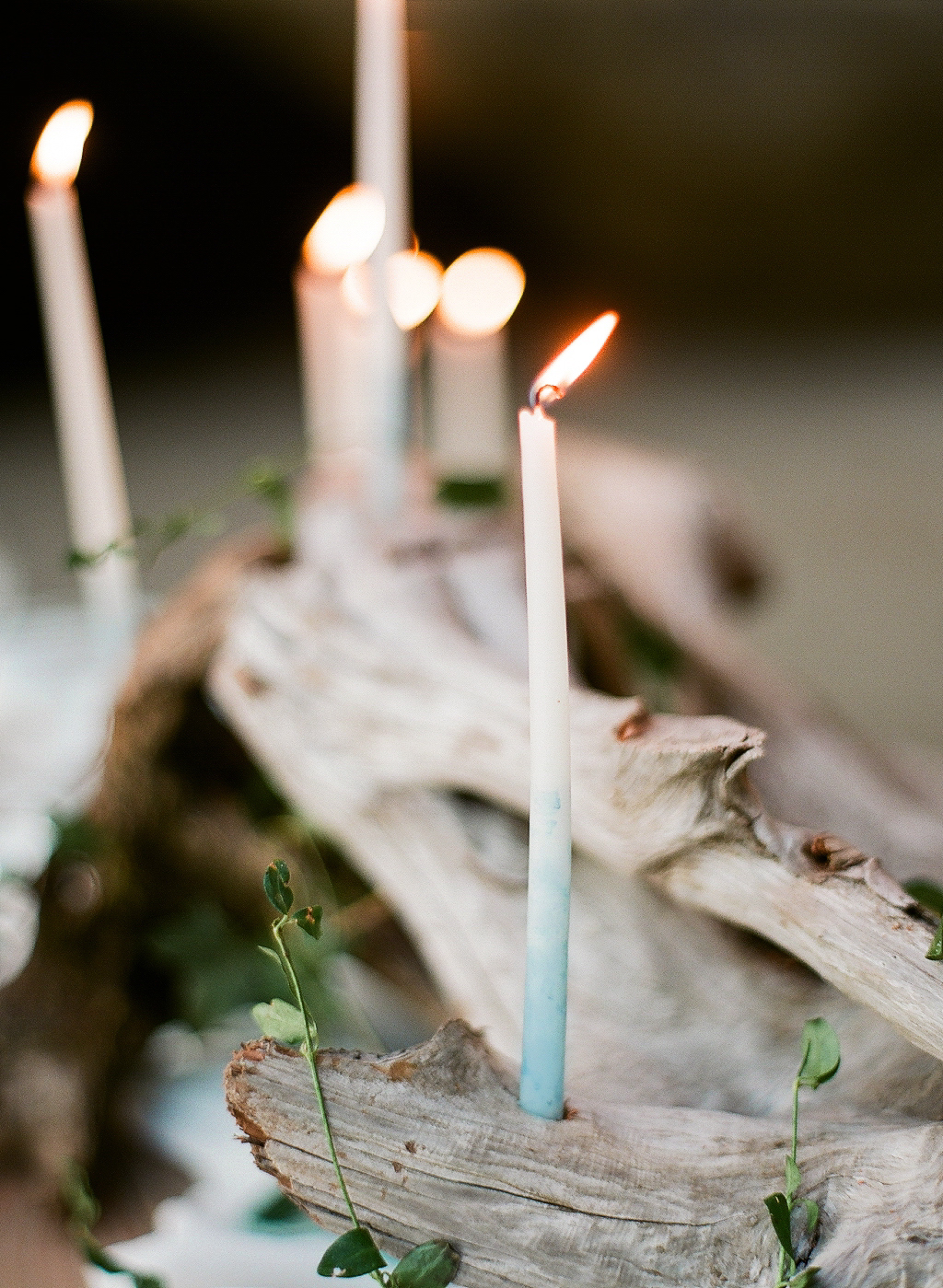 indigo dip-dyed taper candles in a driftwood centerpiece at this coastal wedding at the oregon coast wedding photographed by Destination WEdding Photographer Lexia Frank - a film photographer in portland oregon. TOP DESTINATION WEDDING PHOTOGRAPHY, OREGON COAST WEDDING, WWW DOT LEXIA FRANK DOT COM