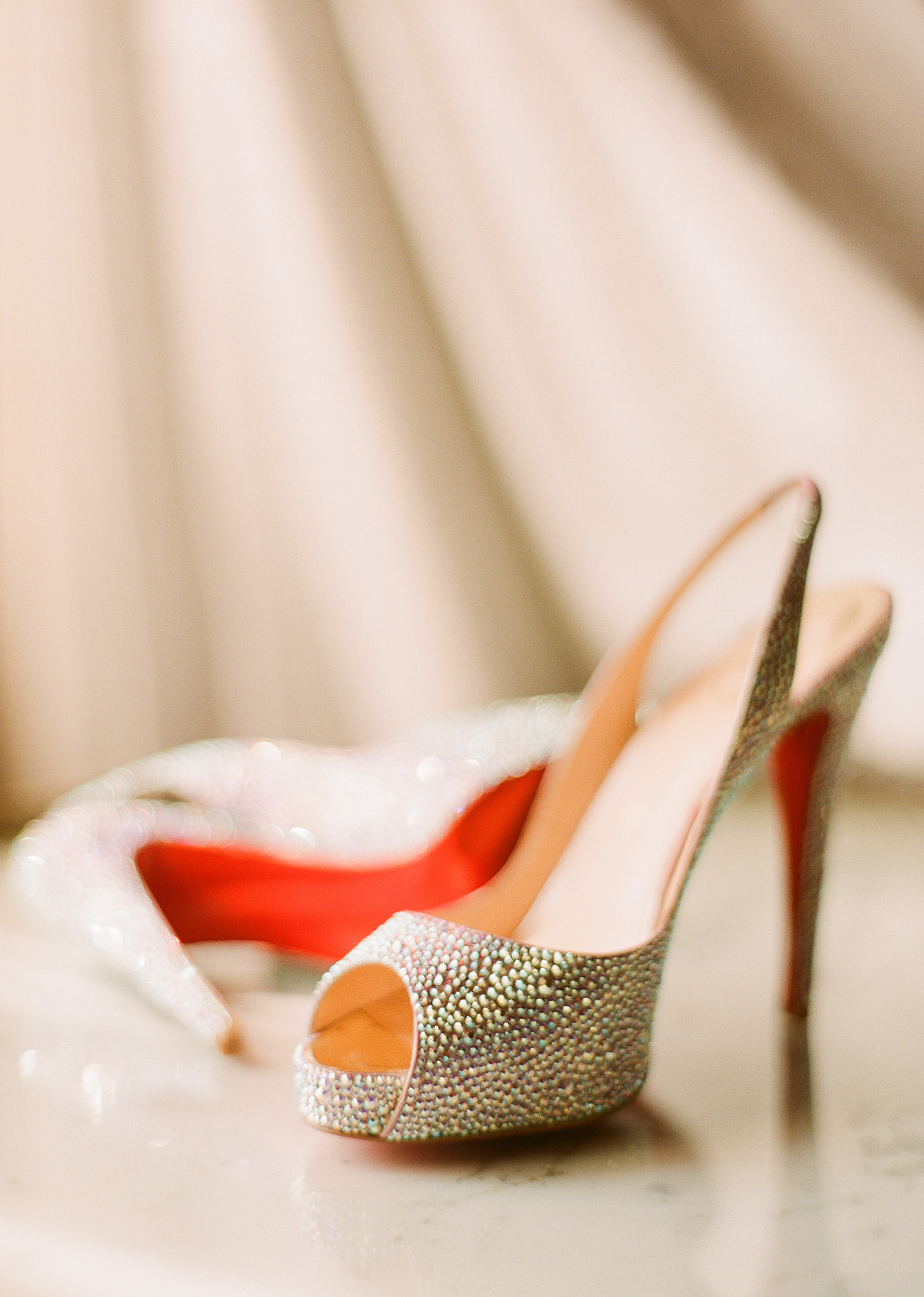 top destination wedding photographer photographs green bay packer Bryan Bulaga and abbie mumpower's wedding and her Christian Louboutin shoes for her wedding.