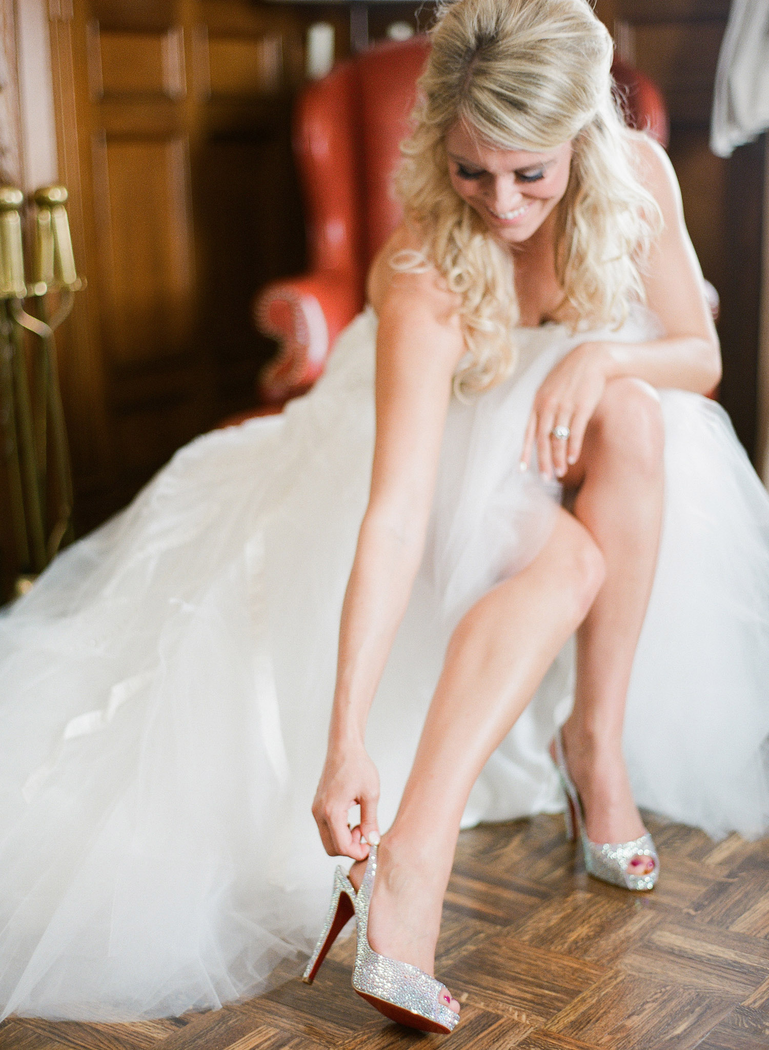 top destination wedding photographer photographs the wedding of NFL football star Bryan Bulaga's wedding in Milwaukee Wisconsin at the Hilton. Abbie is wearing Christian Louboutin heels for her wedding