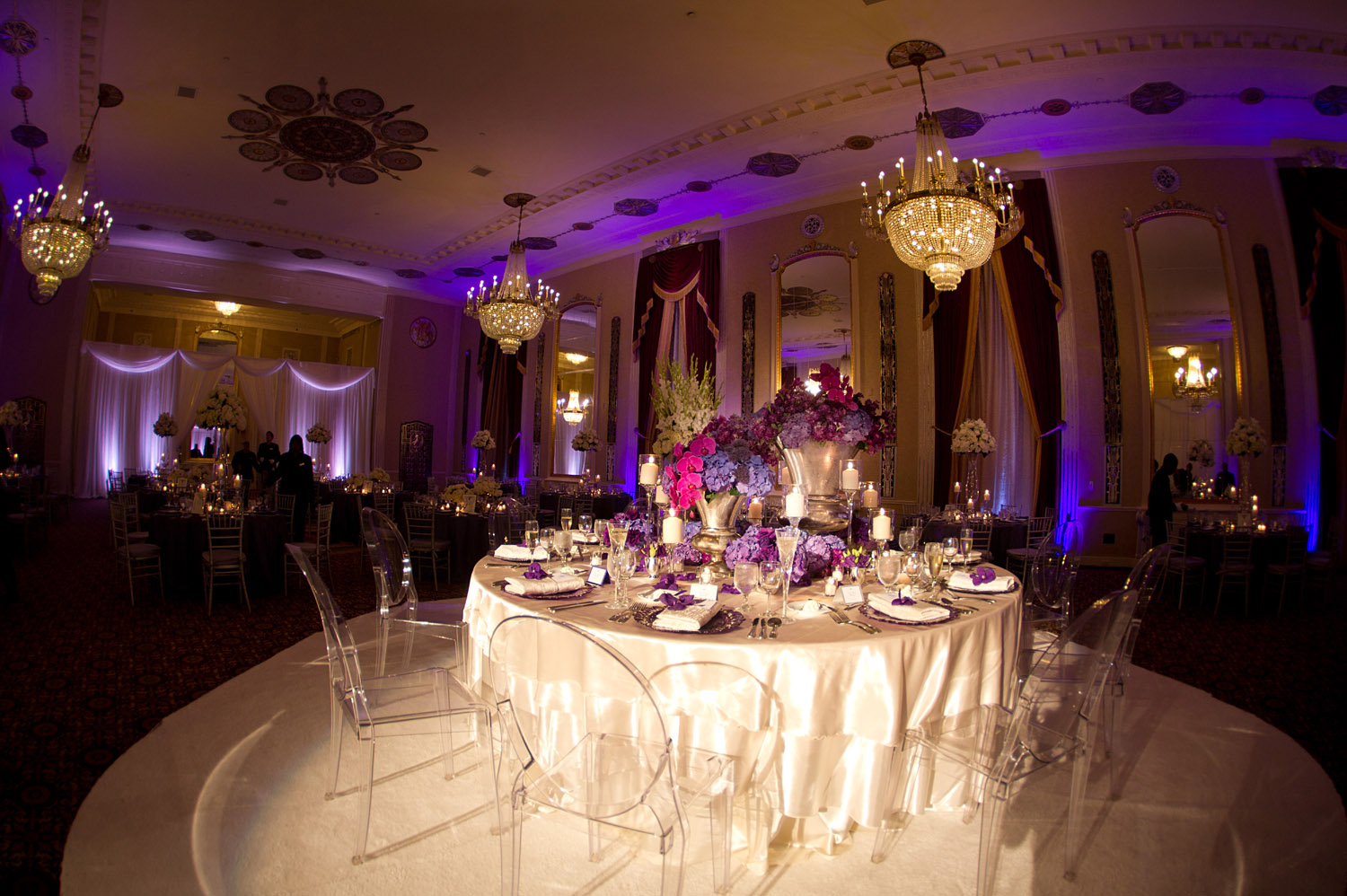 TOP DESTINATION WEDDING PHOTOGRAPHER LEXIA FRANK PHOTOGRAPHS PRO FOOTBALL PLAYER GREEN BAY PACKER BRYAN BULAGAS WEDDING AT THE HILTON CITY CENTER IN DOWNTOWN MILWAUKEE. LUCITE CLEAR CHAIRS WITH PURPLE FLORAL