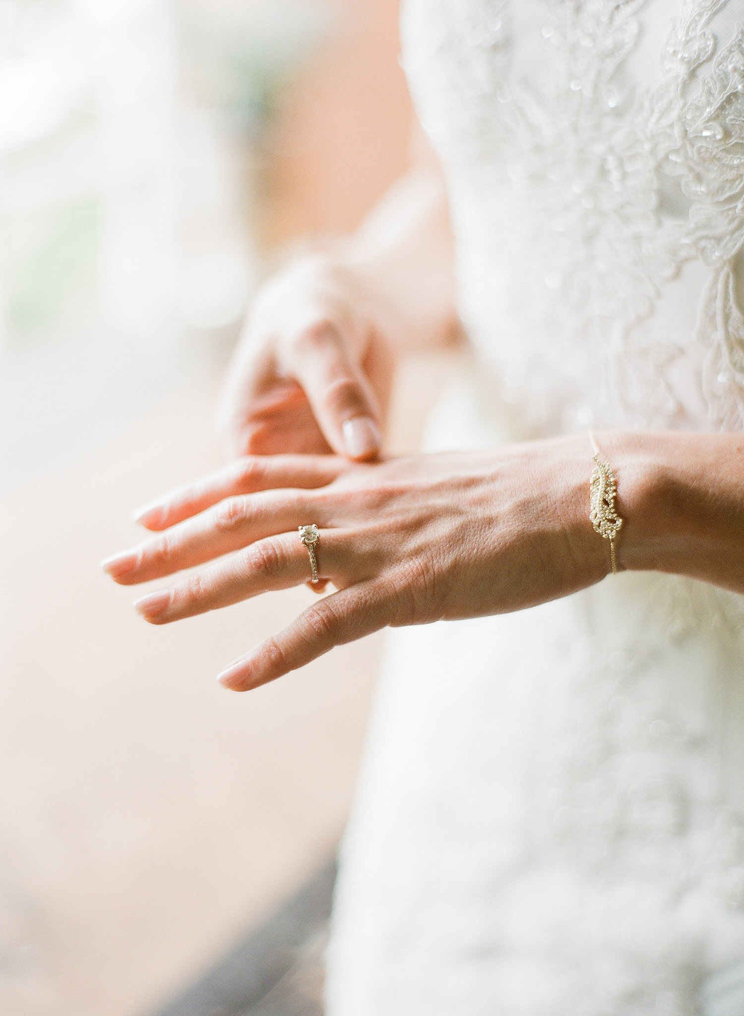 bride wears beautiful vintage jewelry for her wedding while destination wedding photographer Lexia Frank photographs this wedding on film at the Northwind Perennial Garden in wisconsin