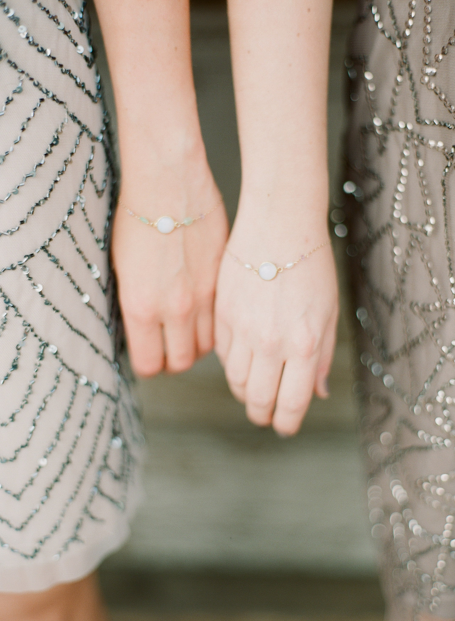 bride gave her bridesmaids gifts of bracelets for her springtime wedding at Northwind Perennial Gardens in wisconsin while Destination wedding photographer lexia frank photographs her wedding in film