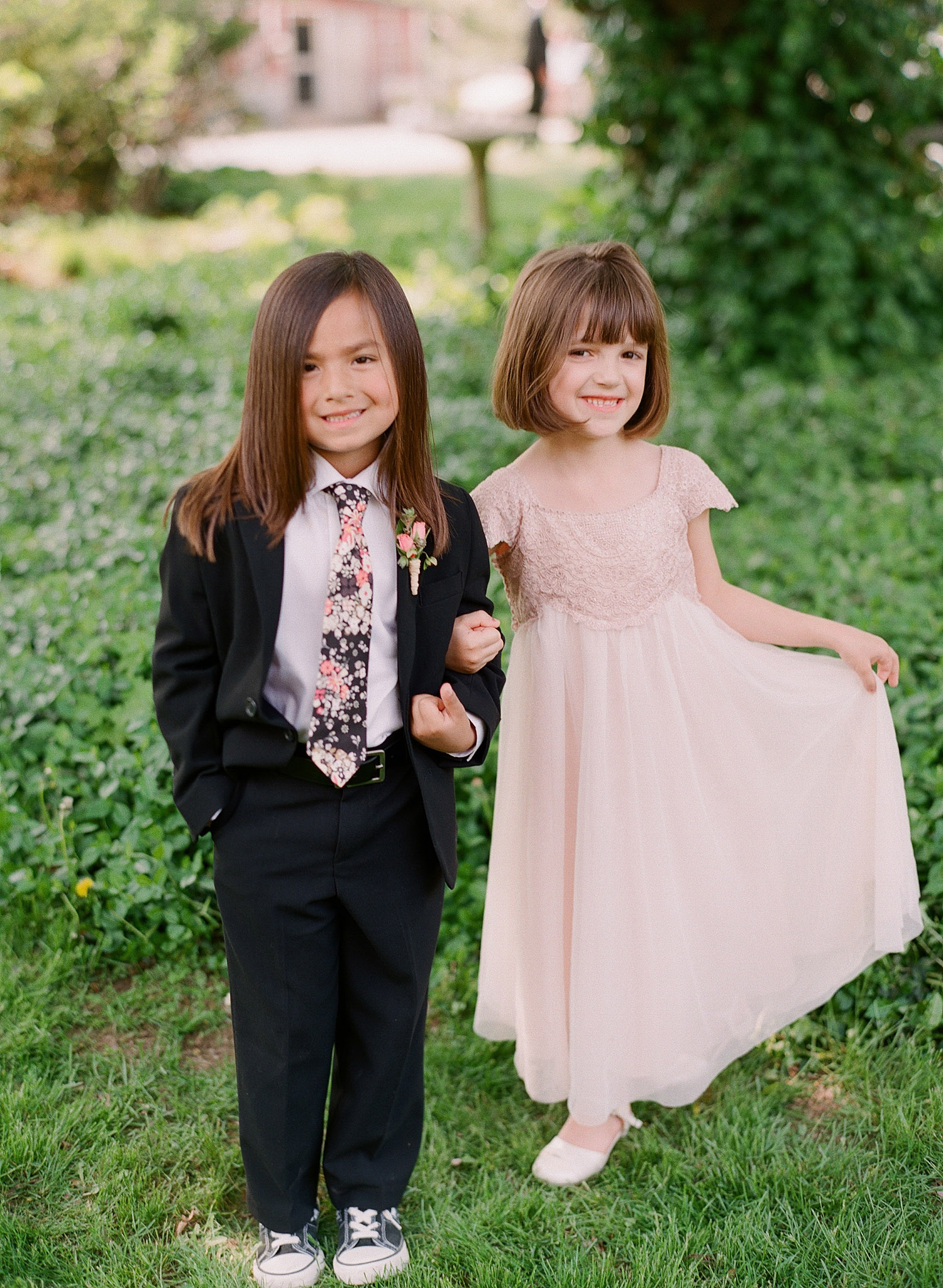 ring bearer and flower girl outfits are adorable at this springtime wedding at Northwind Perennial Garden - a beautiful wisconsin wedding venue - while Destination wedding photographer Lexia Frank Photographs this wedding on film