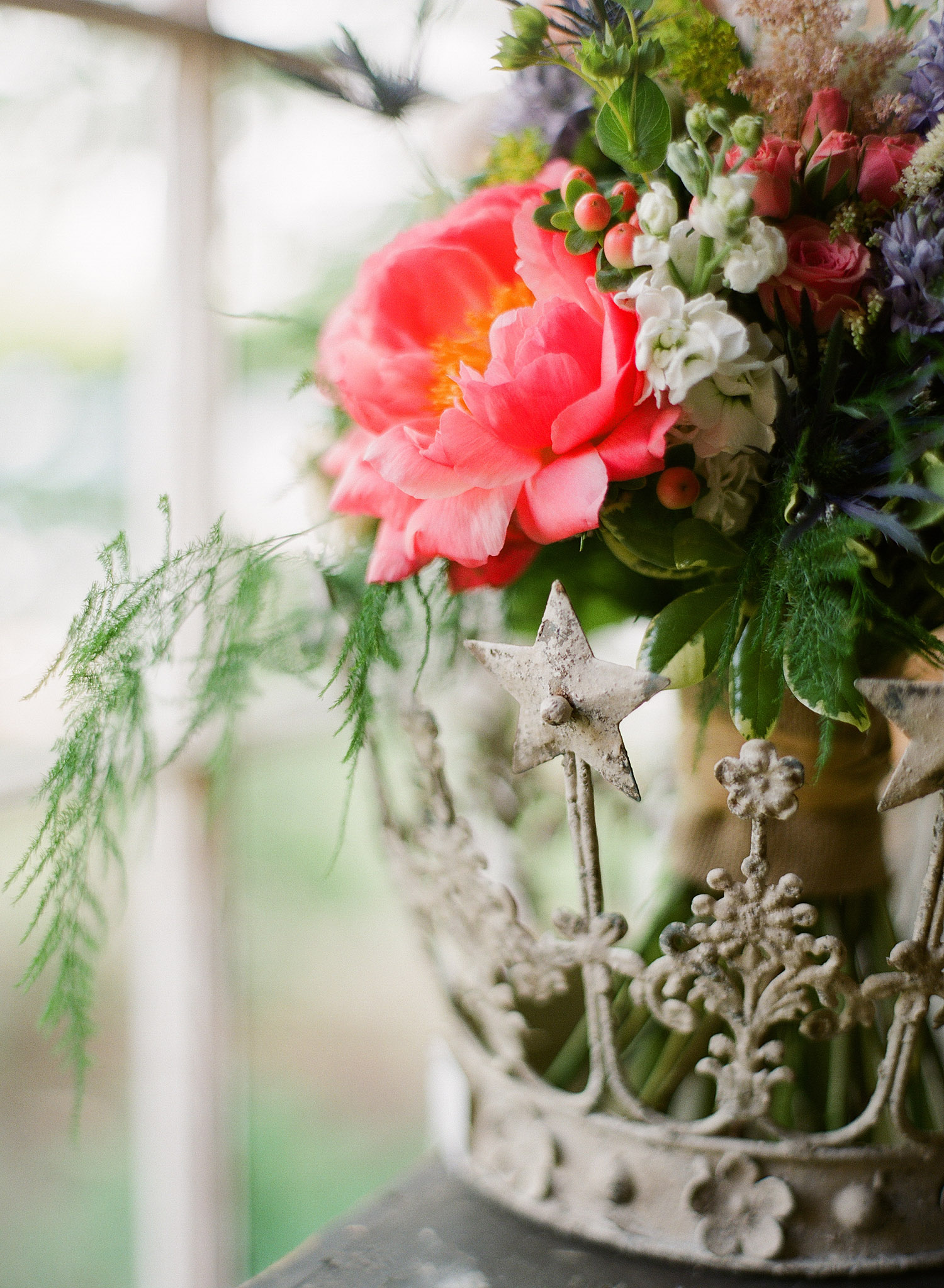 detail image of the peony and ferm asymmetrical bouquet at  this springtime wedding at Northwind Perennial gardens - a wisconsin wedding venue - as a film wedding photographer Lexia Frank photographs this destination wedding on film