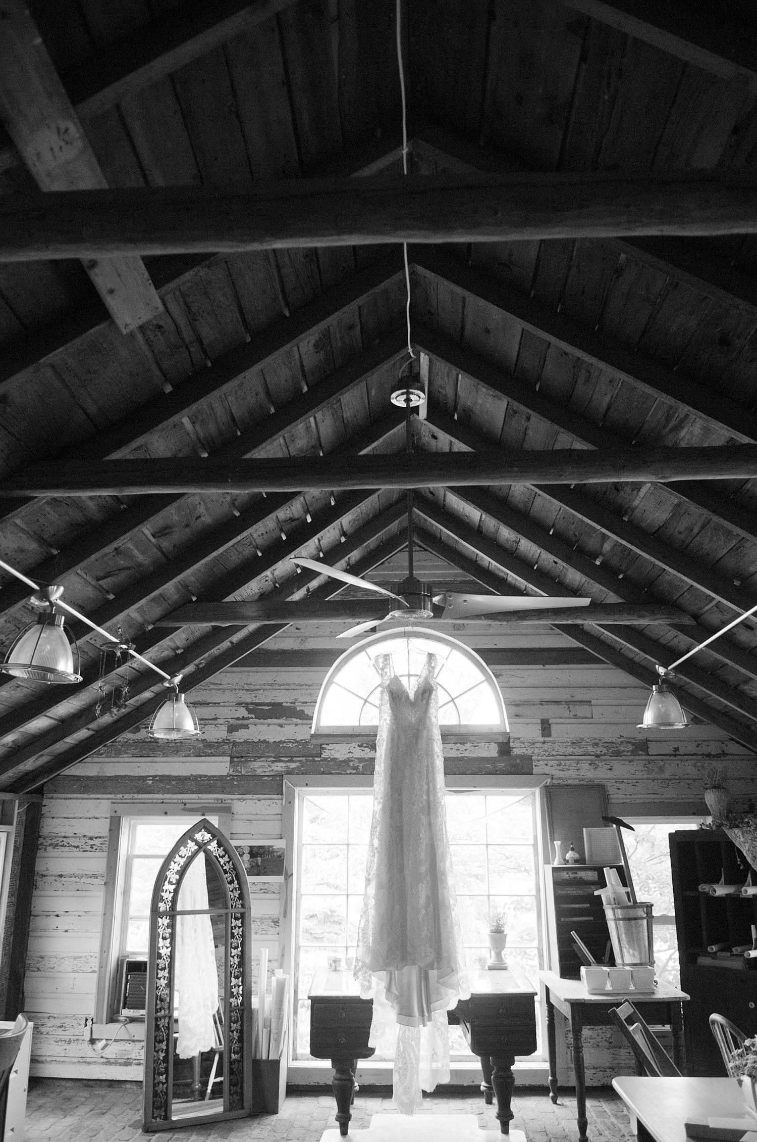 dress hangs from the rafters at this springtime wedding at Northwind Perennial gardens - a wisconsin wedding venue - as a film wedding photographer Lexia Frank photographs this destination wedding on film