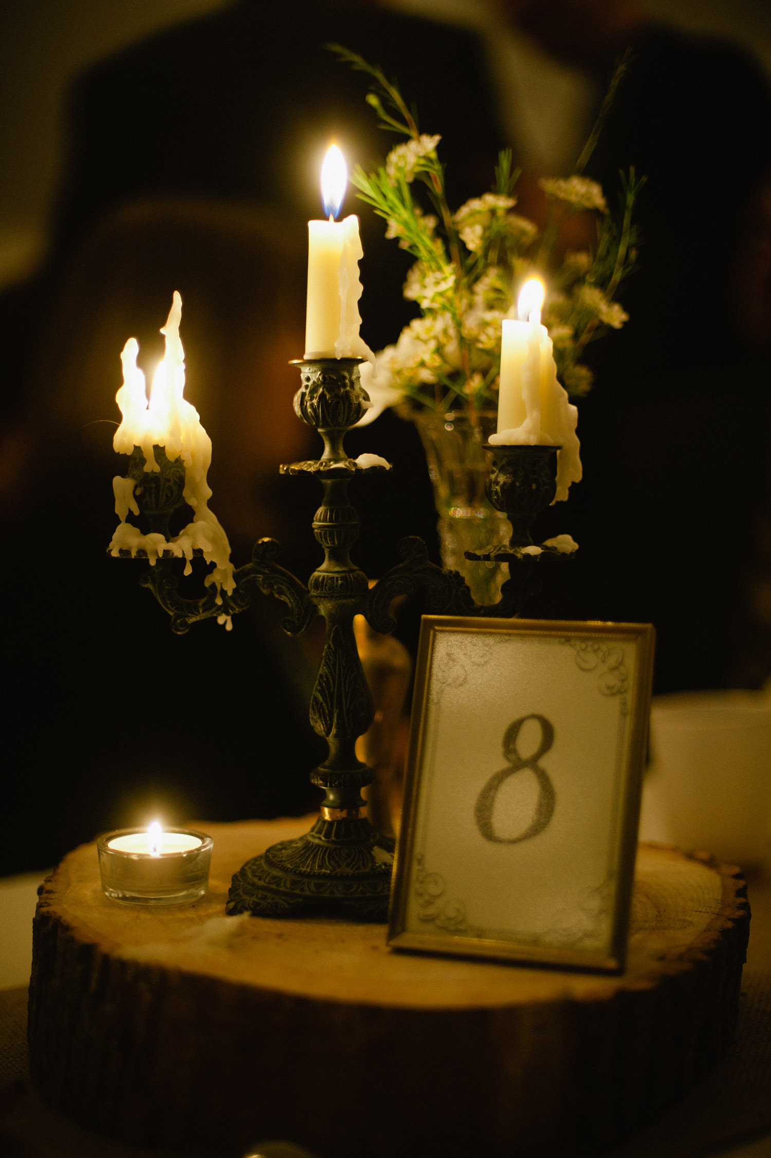 romantic candles light this reception table at this springtime wedding at Northwind Perennial gardens - a wisconsin wedding venue - as a film wedding photographer Lexia Frank photographs this destination wedding on film