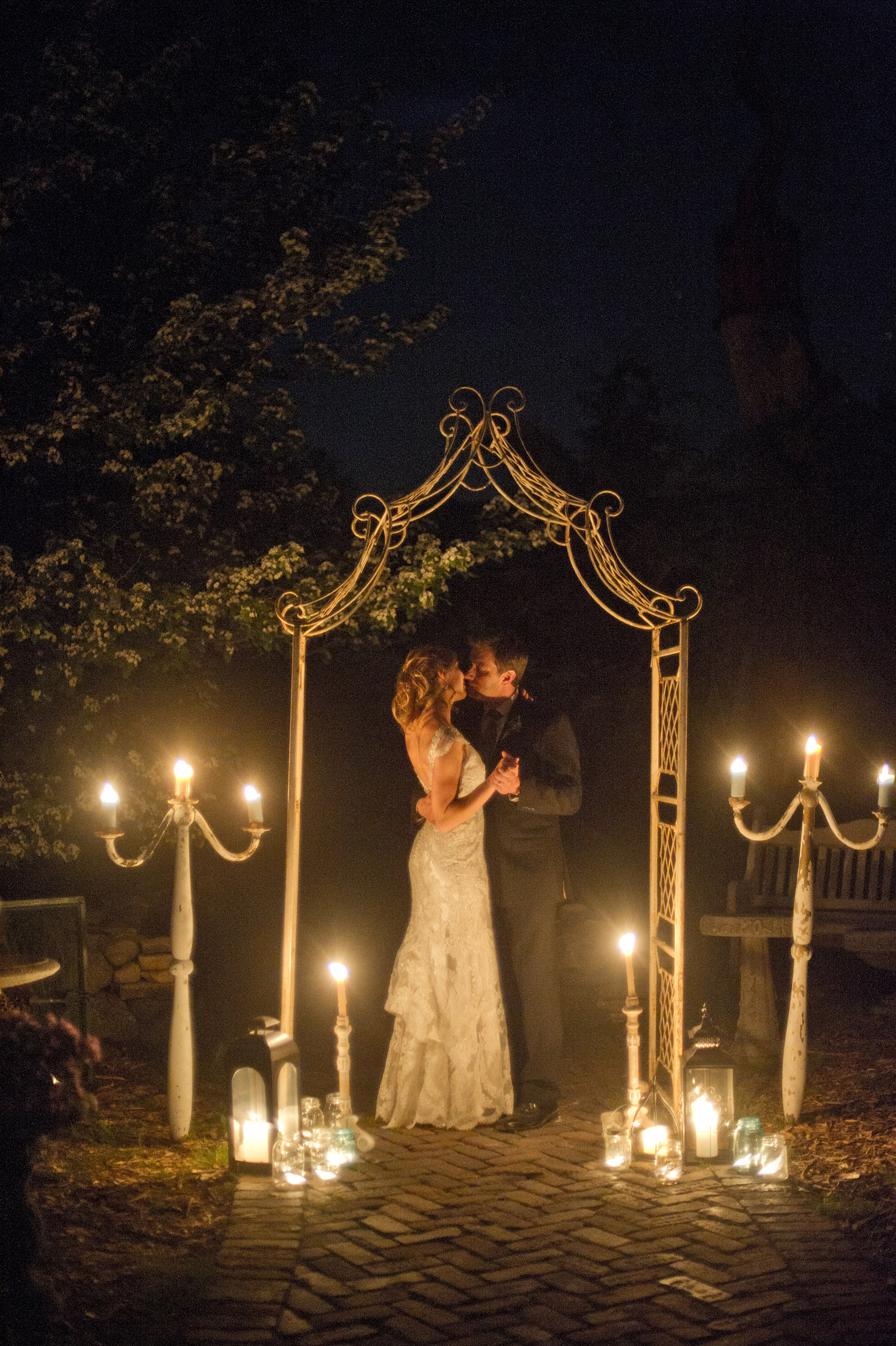 bride and groom share a nighttime photo session during the wedding at this springtime wedding at Northwind Perennial gardens - a wisconsin wedding venue - as a film wedding photographer Lexia Frank photographs this destination wedding on film