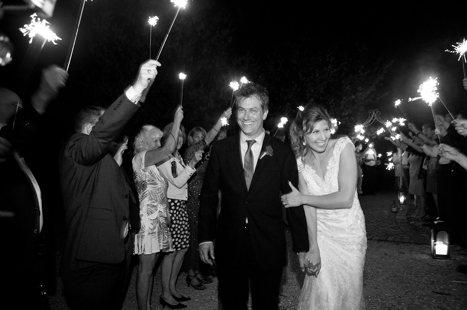 grand exit is a sparkler exit at this springtime wedding at Northwind Perennial gardens - a wisconsin wedding venue - as a film wedding photographer Lexia Frank photographs this destination wedding on film
