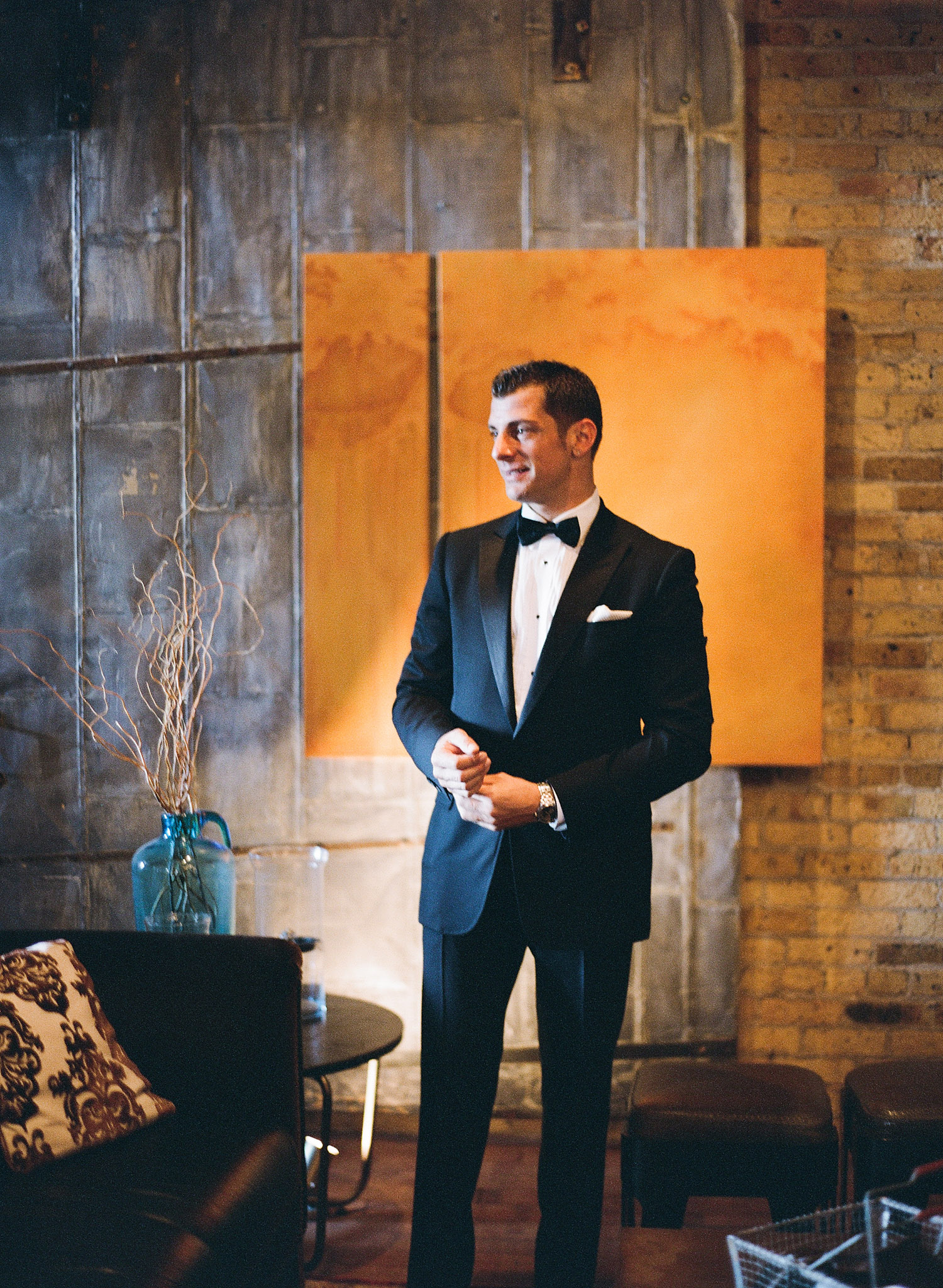 the groom gets ready at this Italian Villa wedding at the Villa Terrace wedding photographed by Destination wedding photographer Lexia Frank who is a film photographer for weddings internationally