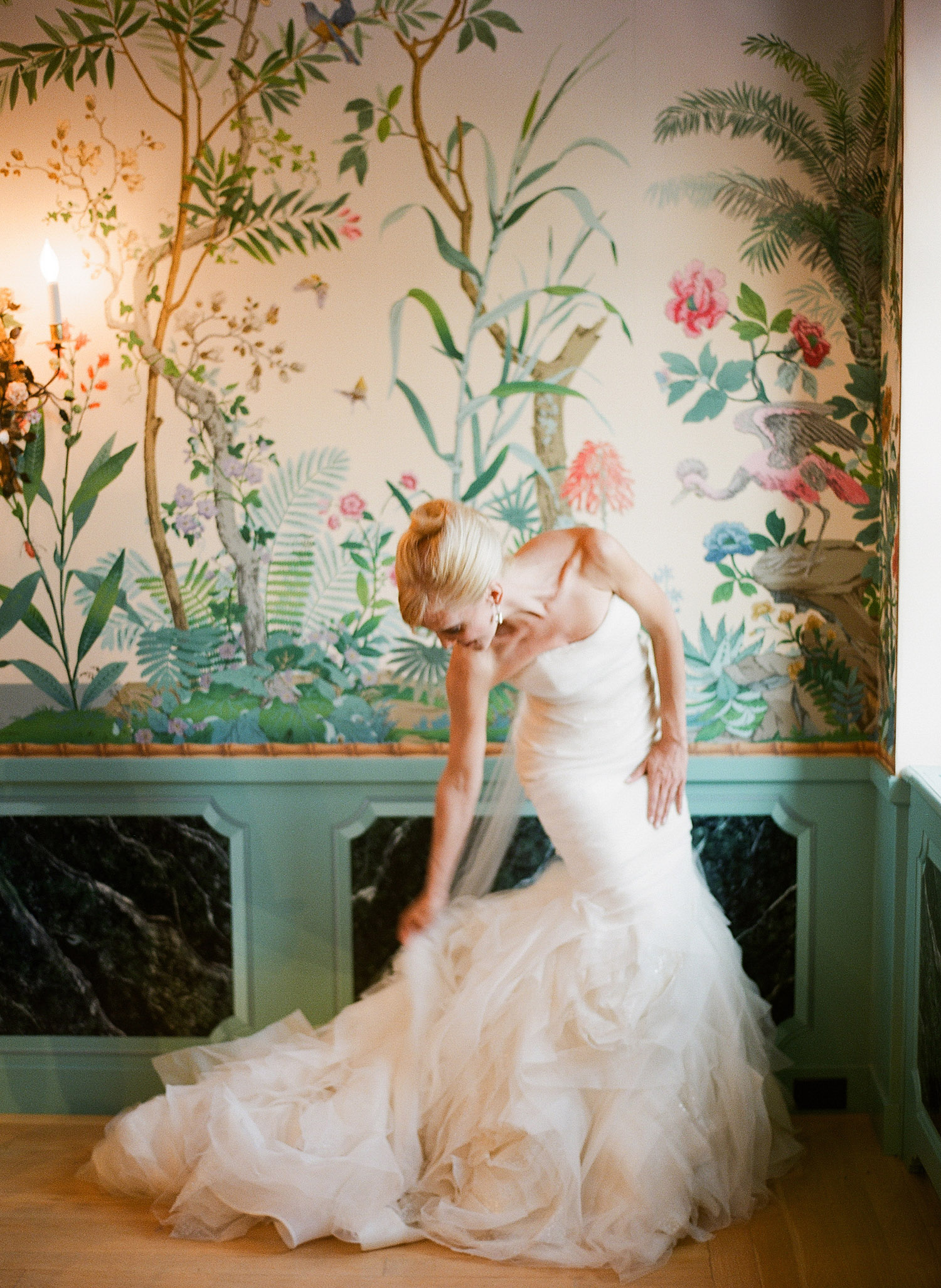 the bride adjusts her huge train in her designer wedding gown at this Italian Villa wedding at the Villa Terrace where Destination wedding photographer, Lexia Frank photographs the wedding entirely on film