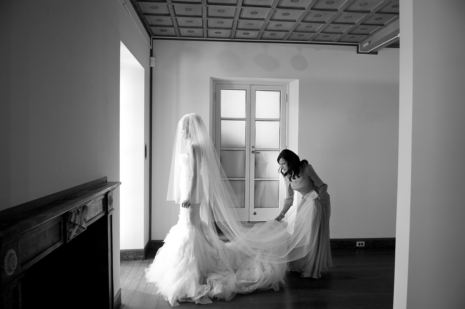 the mother of the bride puts the veil on the bride at this Italian Villa wedding at the Villa Terrace Wedding photographed by destination wedding photographer, lexia frank, who shot the entire wedding on film