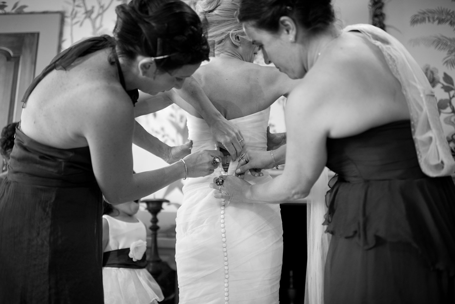 bridesmaids help the bride get dressed at this destination italian wedding at the Villa Terrace where destination wedidng photographer LExia Frank photographs this italian destination wedding entirely on film because she is a film photographer for weddings