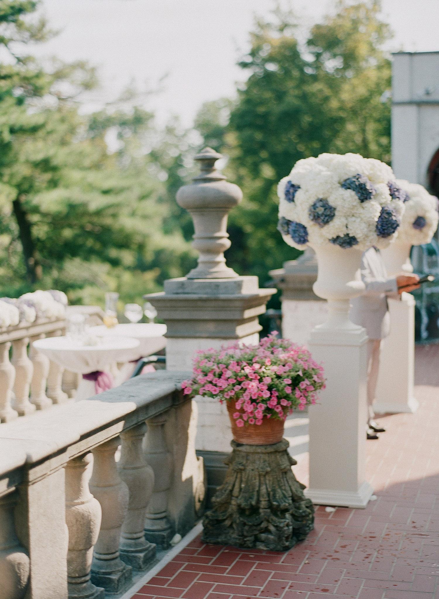 floral arrangements of vintage purple hydrangeas at the Italian Destination Wedding at the Villa Terrace - a favorite wedding venue of international wedding photographer, Lexia Frank, who is a film photographer for luxury weddings worldwide.