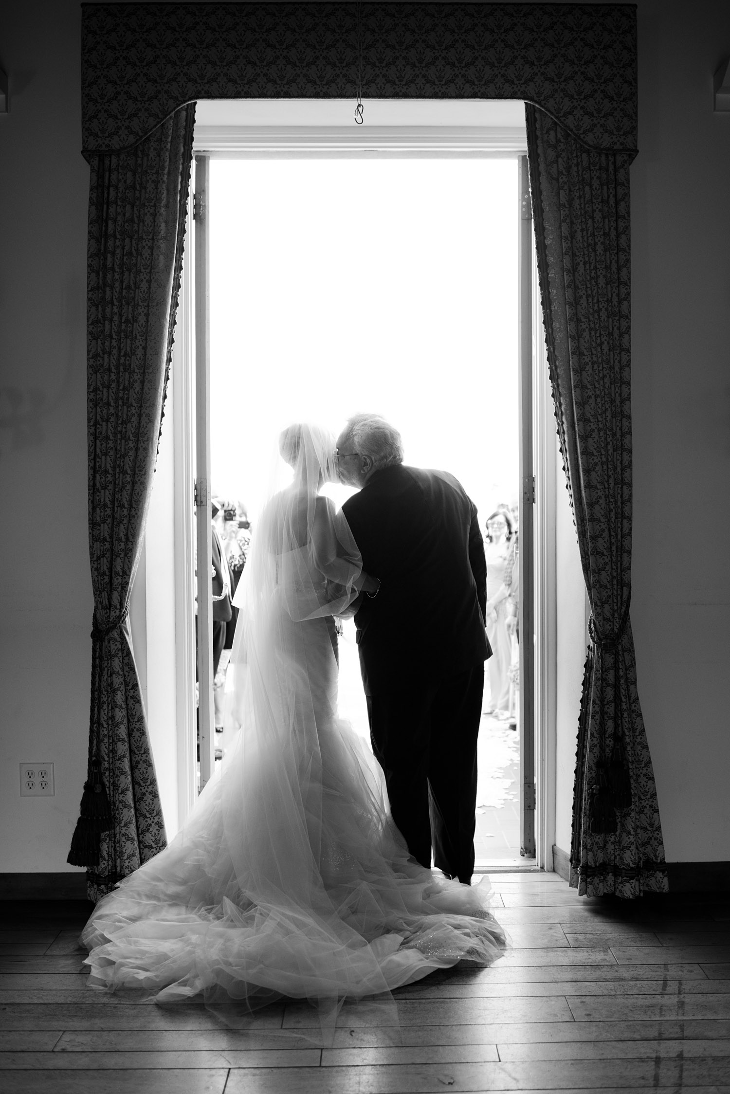 father of the bride escorts the bride down the aisle at this Destination Italian wedding at the Villa Terrace - a favorite wedding venue of international destination wedding photographer LExia Frank who is a film photographer of luxury weddings