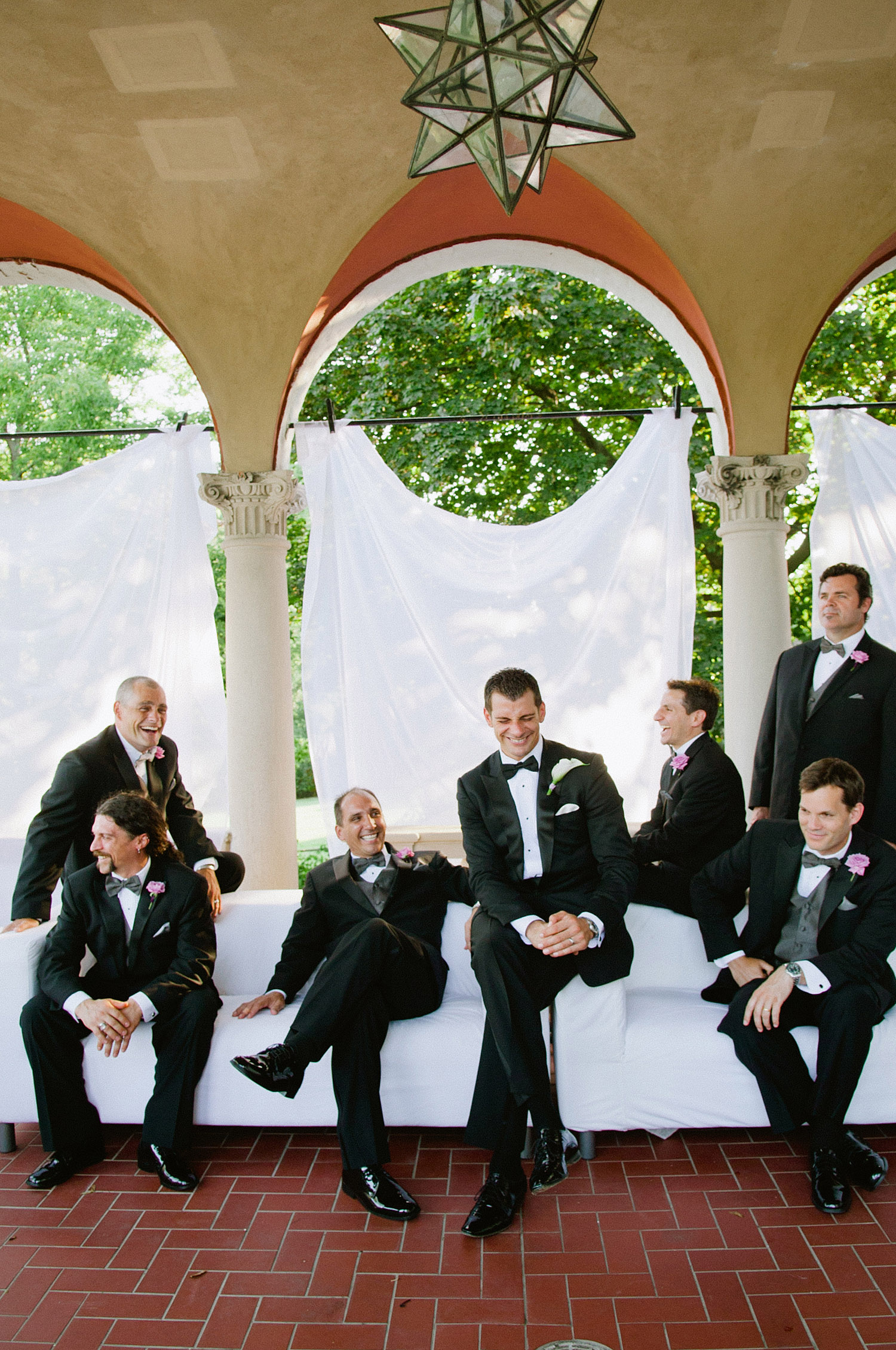 the groomsmen hang out during their Destination Italian Wedding at the Villa Terrace - where Destination Wedding Photographer Lexia Frank loves to shoot film for her luxury weddings