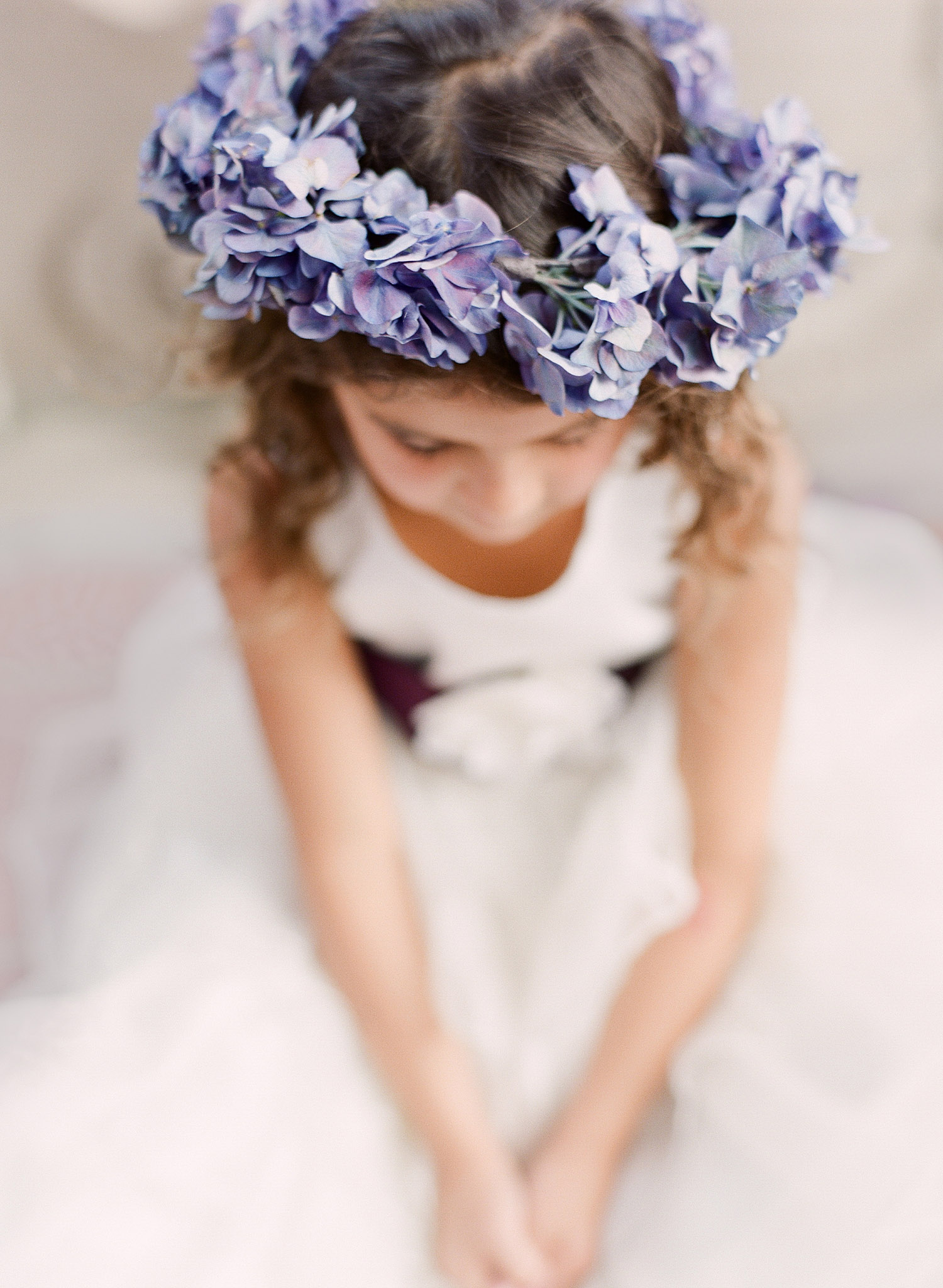 a hydrangea crown of flowers for the flower girl is beautiful at this Destination Italian Wedding at the Villa Terrace- a lovely wedding venue where Destination Wedding Photographer Lexia Frank loves to shoot film for her luxury weddings