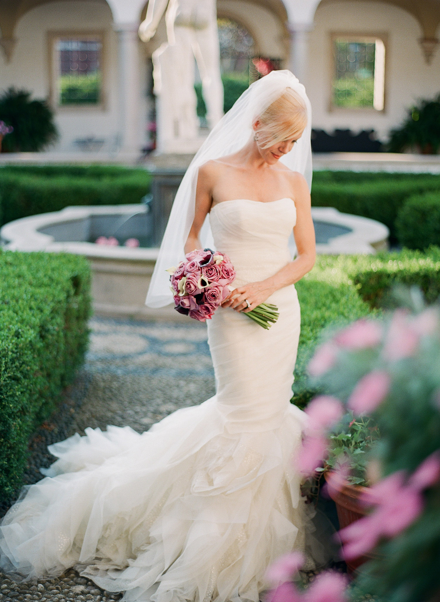 bride and groom pose at their Destination Italian Wedding at the Villa Terrace, a favorite Italian Wedding venue of Destination wedding photographer Lexia Frank, who is a film photographer for luxury weddings