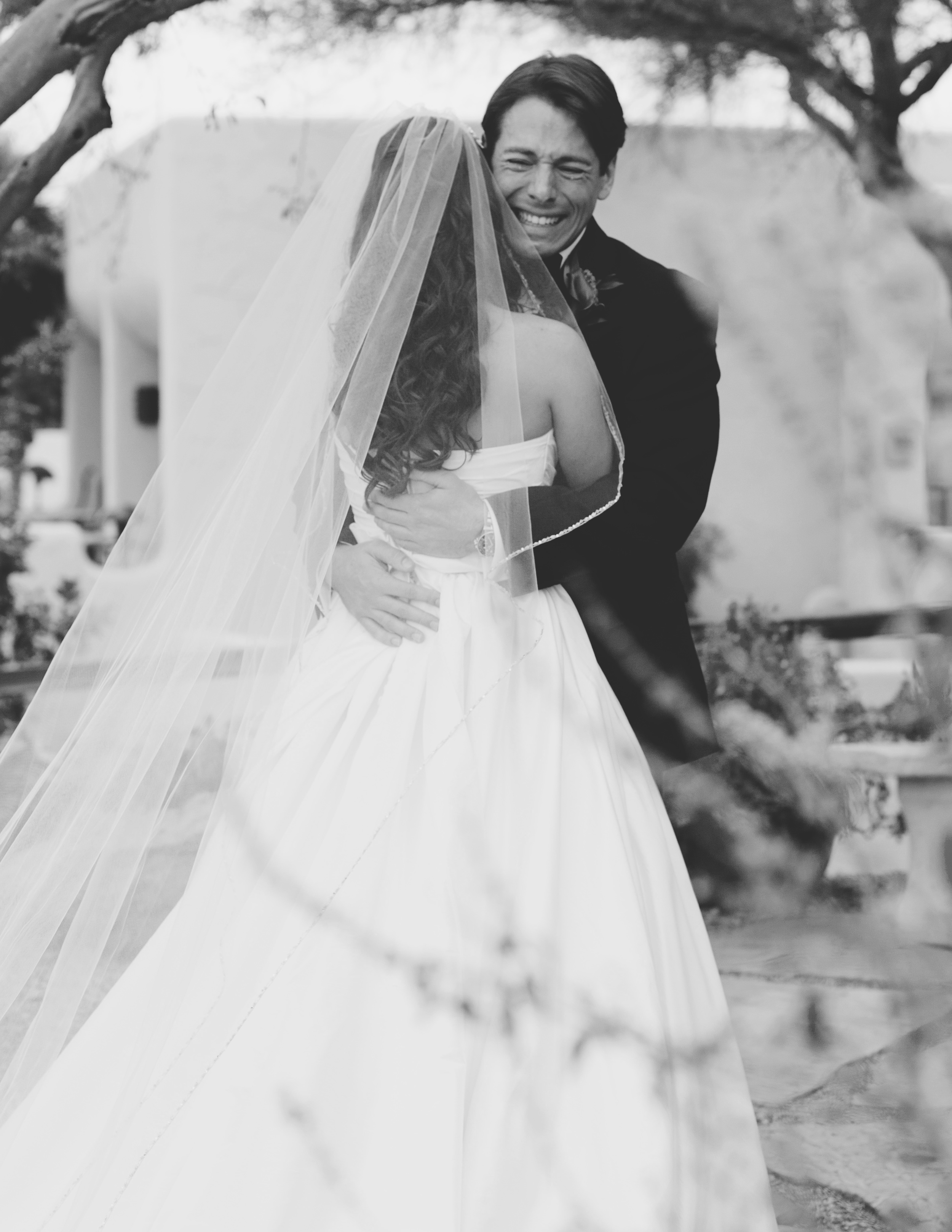Groom sees the bride at the first-look and cries at the Camelback inn wedding in Scottsdale While Destination wedding photographer Lexia Frank photographs the wedding on film