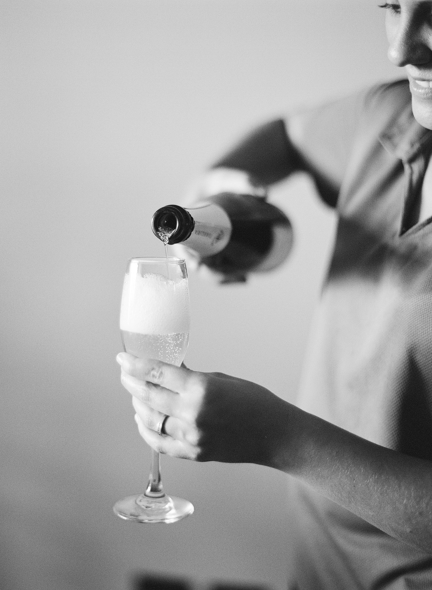 champagne is poured at this destination wedding at the W hotel in Vieques Island Puerto Rico while Destination wedding photographer Lexia Frank photographs this vieques Wedding Photographer on film