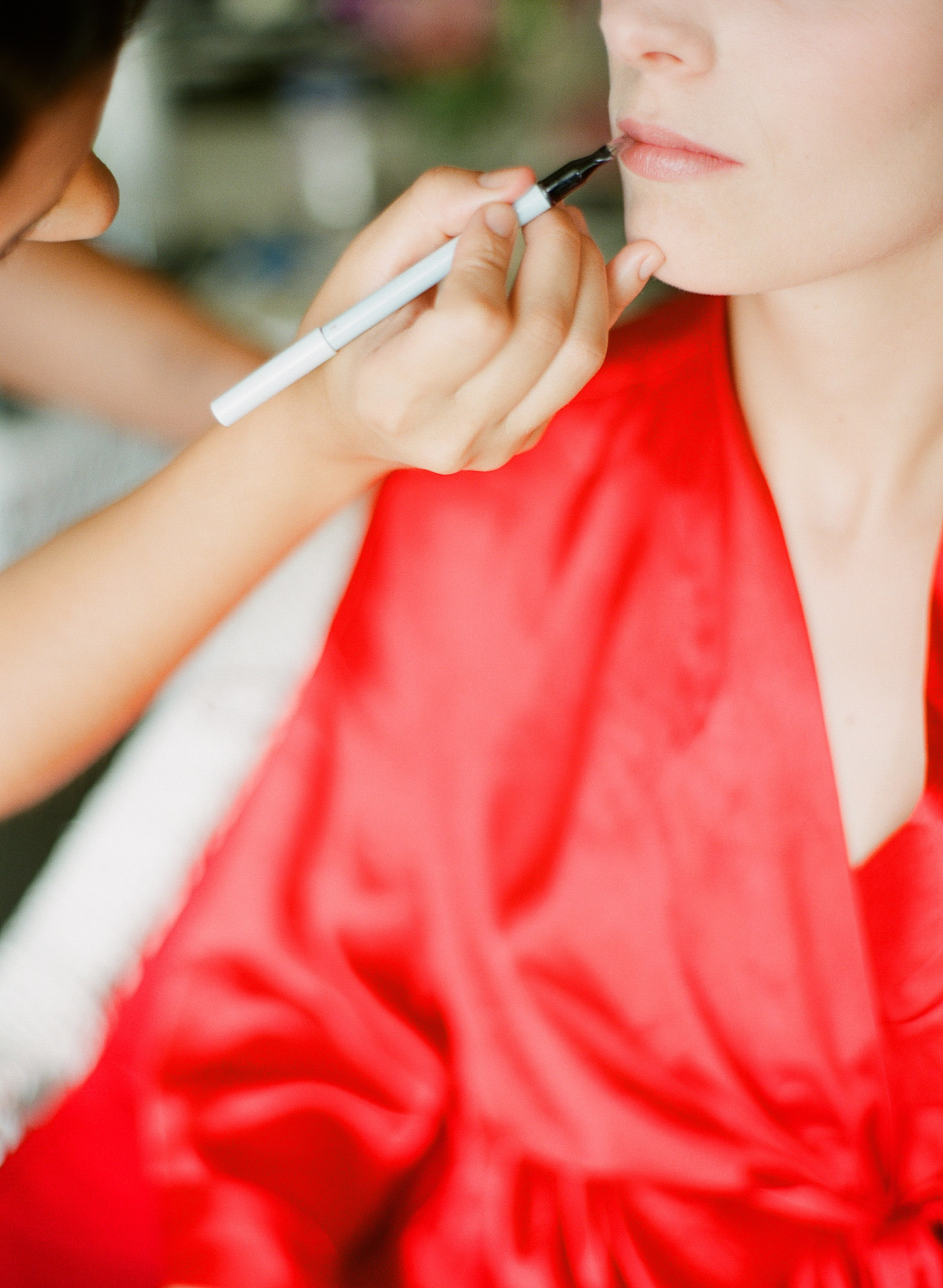 destination wedding photographer, Lexia Frank, a film photographer for weddings, photographs this destination wedding at vieques island at the W hotel, as a bride gets her makeup done at this vieques island wedding