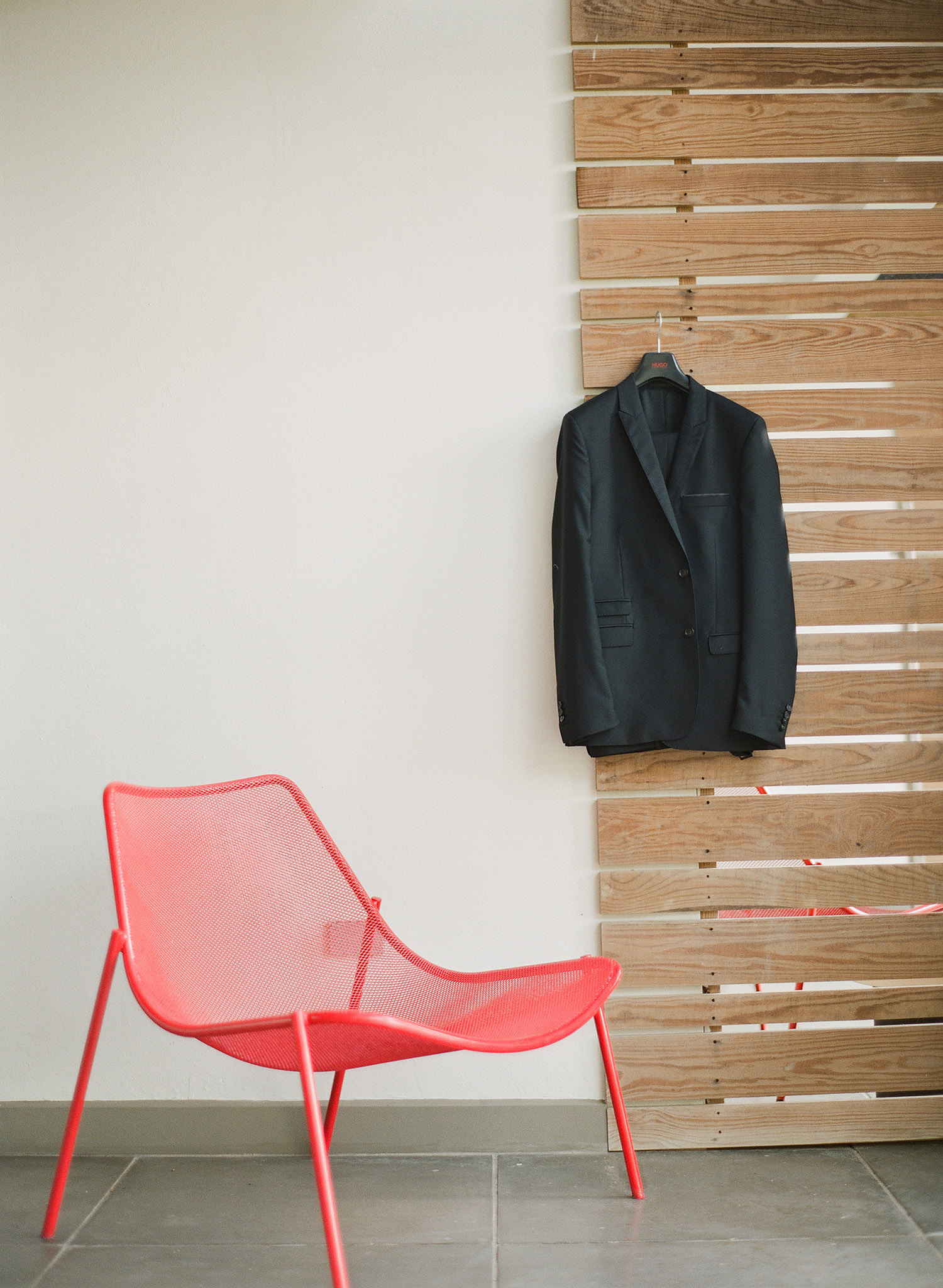 the groom's jacket hangs outside his room at this destination wedding in vieques island at the W hotel while destination wedding photographer, Lexia Frank, a film photographer shooting destination weddings worldwide photographs their vieques island wedding on film