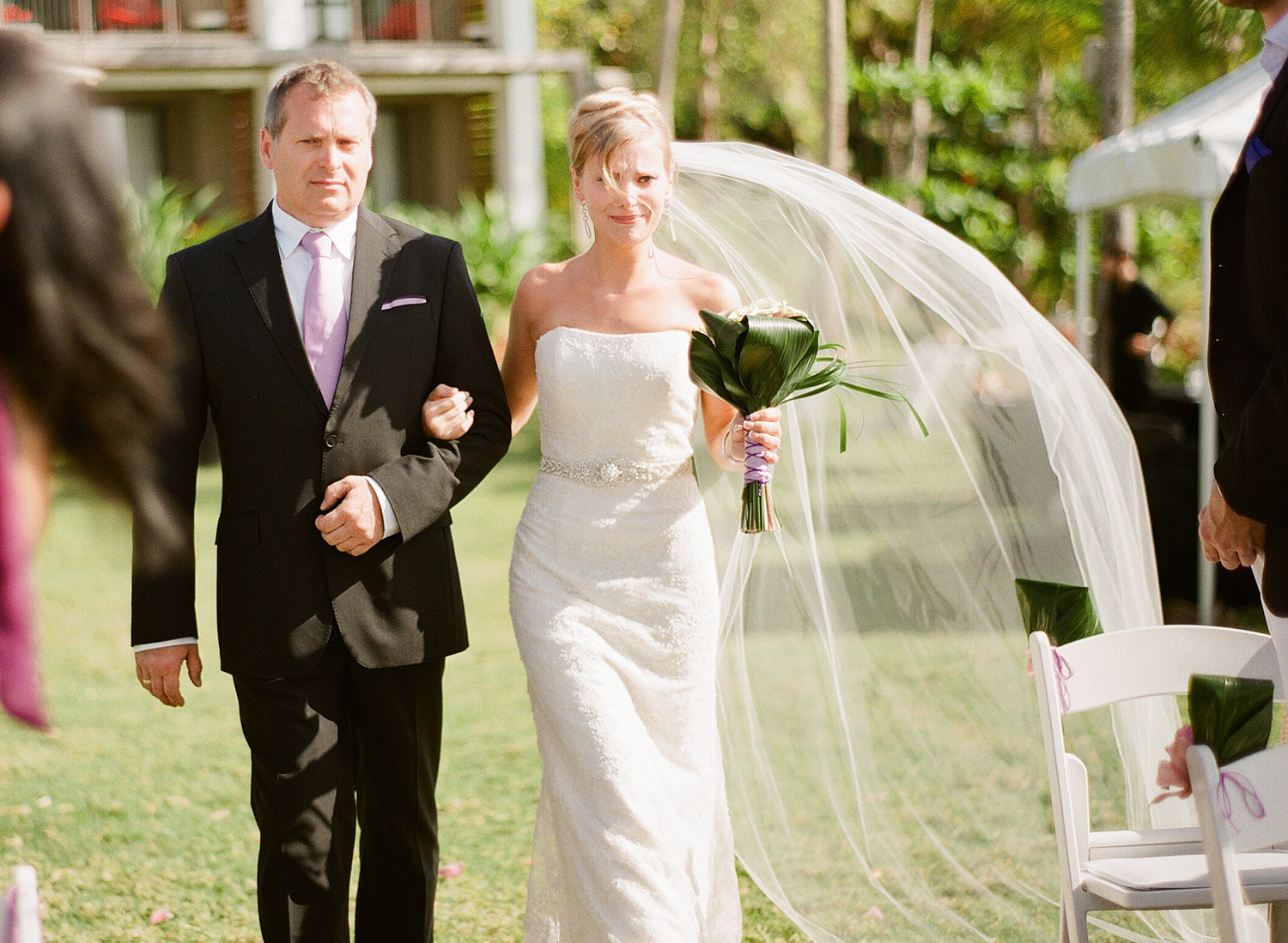 bride walks down the aisle crying at her Vieques ISland wedding at the W hotel. the wind catches her veil as Destination Wedding Photographer Lexia Frank photographs their wedding on film, as she is a destination wedding photographer and film photographer