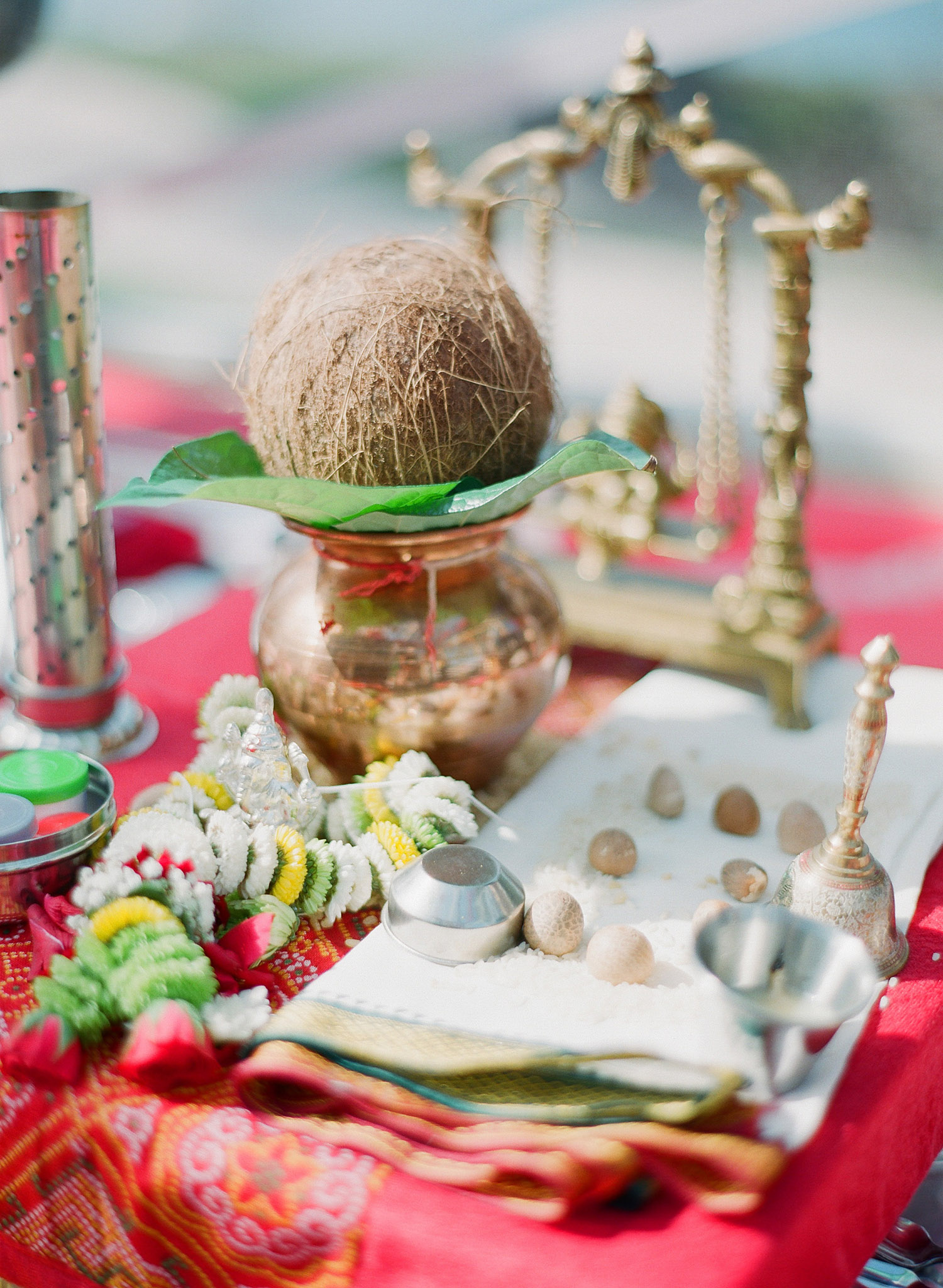 hindu ceremony items for the pithi ceremony at this indian wedding in Palm Coast Florida at the hammock beach resort planned by Reveology Events and photographed by Destination Wedding Photographer Lexia Frank, a top indian wedding photographer who photographs indian weddings on film, a film photographer for indian weddings, shooting luxury indian weddings in florida and worldwide