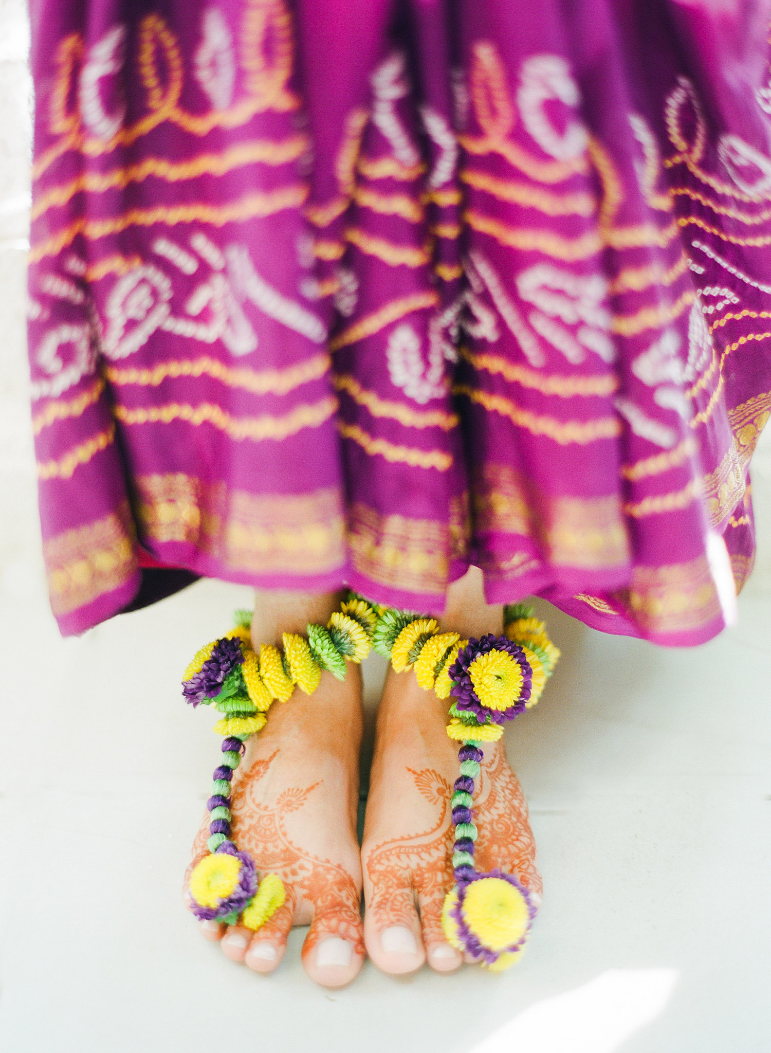 foot jewelry for this indian wedding is actually made of flowers- a floral indian anklet - for this hindu wedding in palm coast florida at the hammock beach resort photographed by Destination Wedding photographer Lexia Frank, a top indian wedding photographer who shoots film for weddings with medium format cameras for her luxury indian weddings worldwide