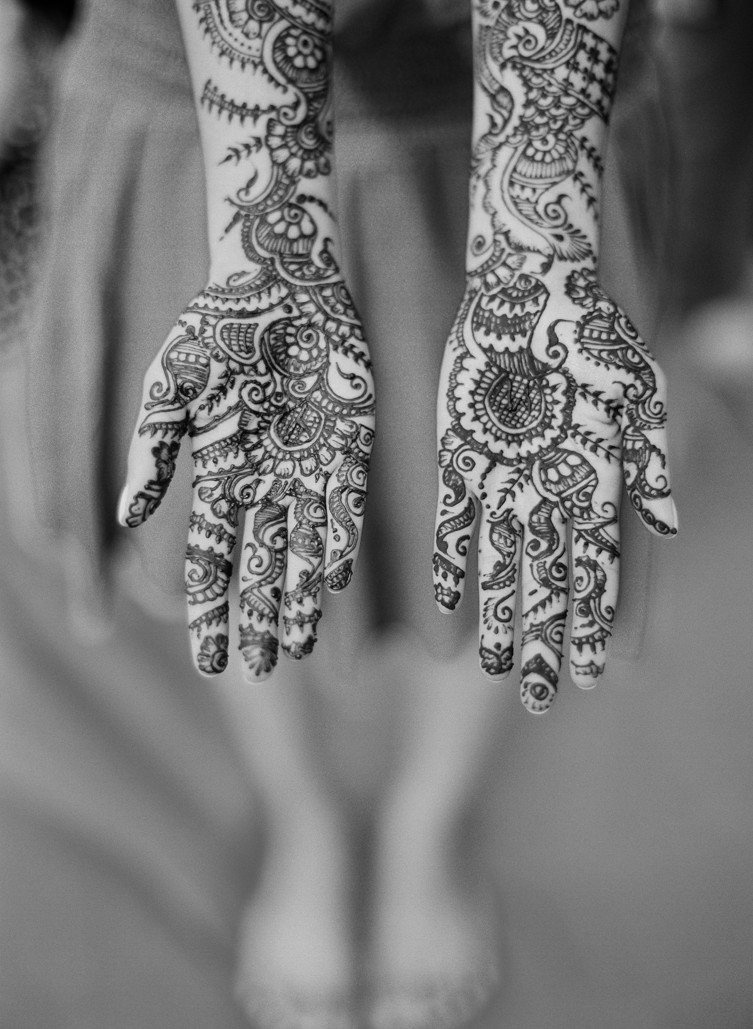 a beautiful Mehndi design is applied with henna at this hindu wedding reception in miami where Destination WEdding Photographer, Lexia Frank, a top indian wedding photographer, photographs this luxury indian wedding on film, preferring to shoot indian weddings on film because of the tonal ranges and bright indian colors. she photographs indian weddings in india, florida, and worldwide and her brides love maharani weddings, south asian bride and suneet varma and manish malhotra