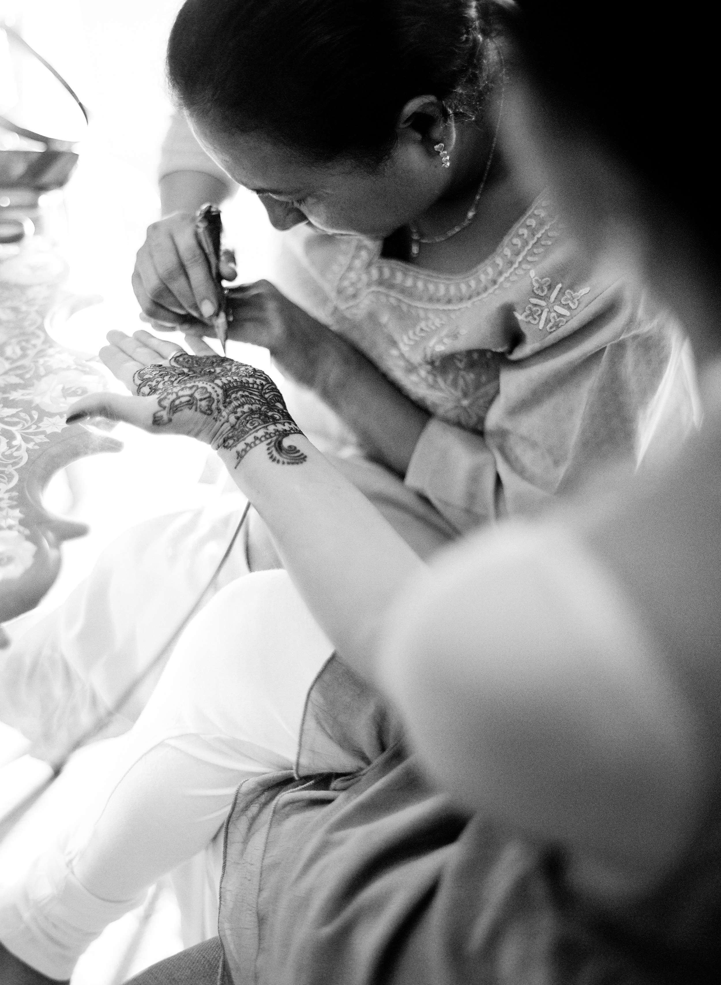 beautiful mehndi designs are done with henna at this beautiful hindu wedding in florida photographed by Destination Wedding Photographer LExia Frank, a top indian wedding photographer, who photographs her luxury indian weddings on film preferring it's tonal range and bright colors for indian weddings in india, florida and worldwide. her brides love maharani weddings, south asian bride, suneet varma and manish malhotra