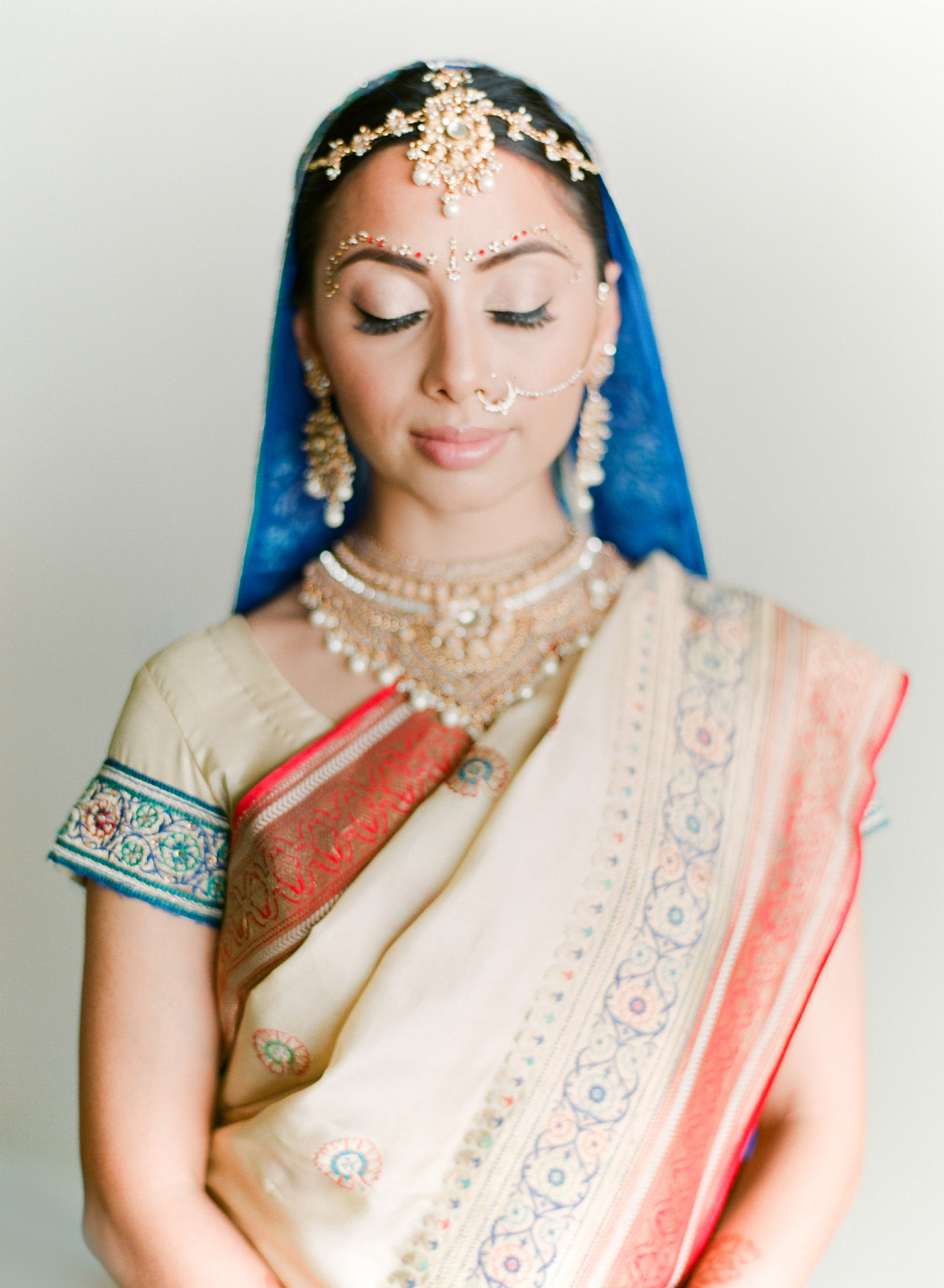 destination indian wedding photographer, Lexia Frank, a top indian wedding photographer for luxury indian weddings, photographs this hindu bride wearing her mother's vintage saree on film as she is a film photographer for indian weddings because she prefers the beautiful skin tones and vibrant colors for indian weddings in india and worldwide. manish malhotra and suneet varna