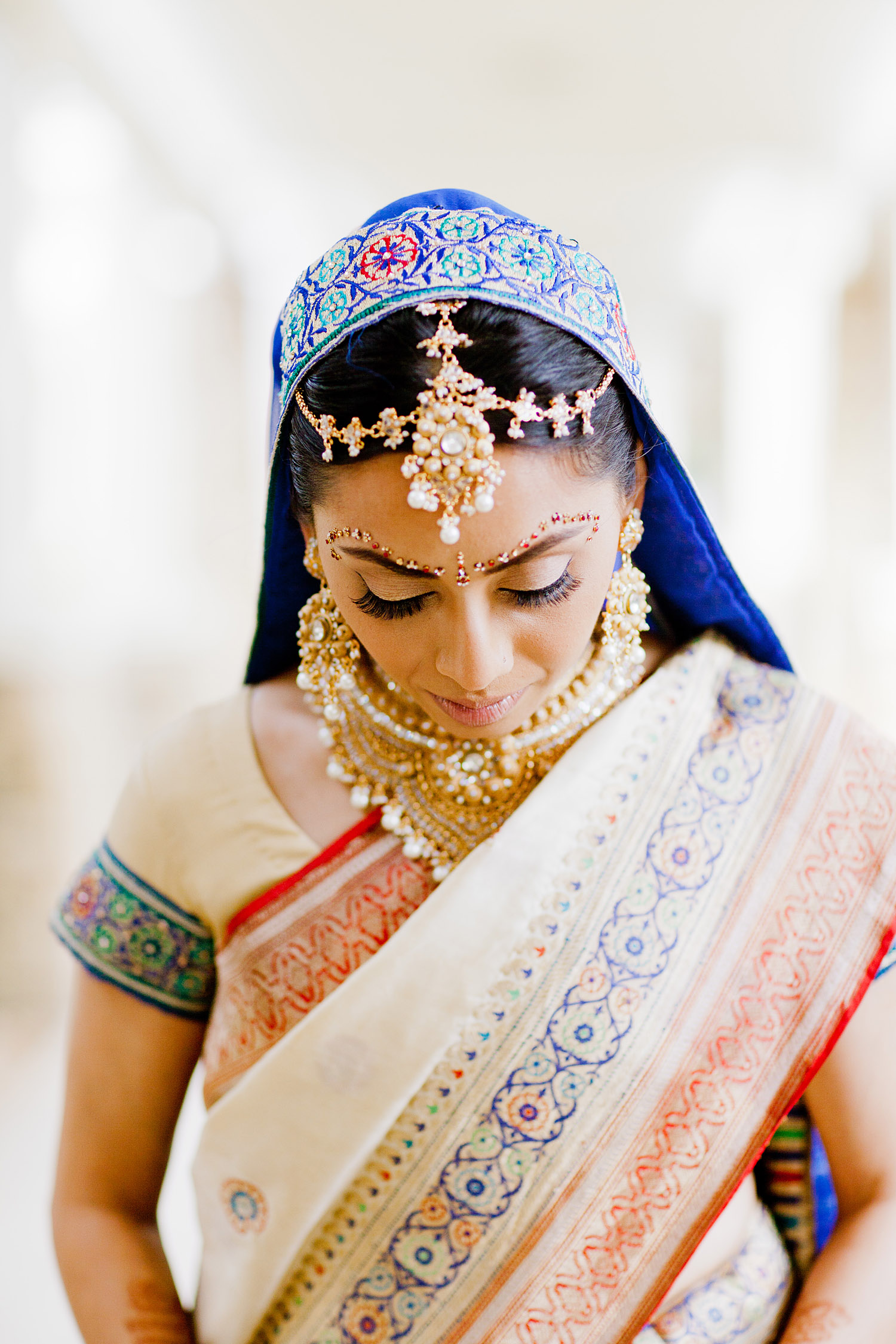 Hindu bride during her indian wedding wearing her mother's saree photographed by Destination wedding photographer LExia Frank, a top indian wedding photographer for luxury indian weddings, photographs this luxury indian wedding on film because she prefers film photography for indian weddings because of the vibrant colors of film
