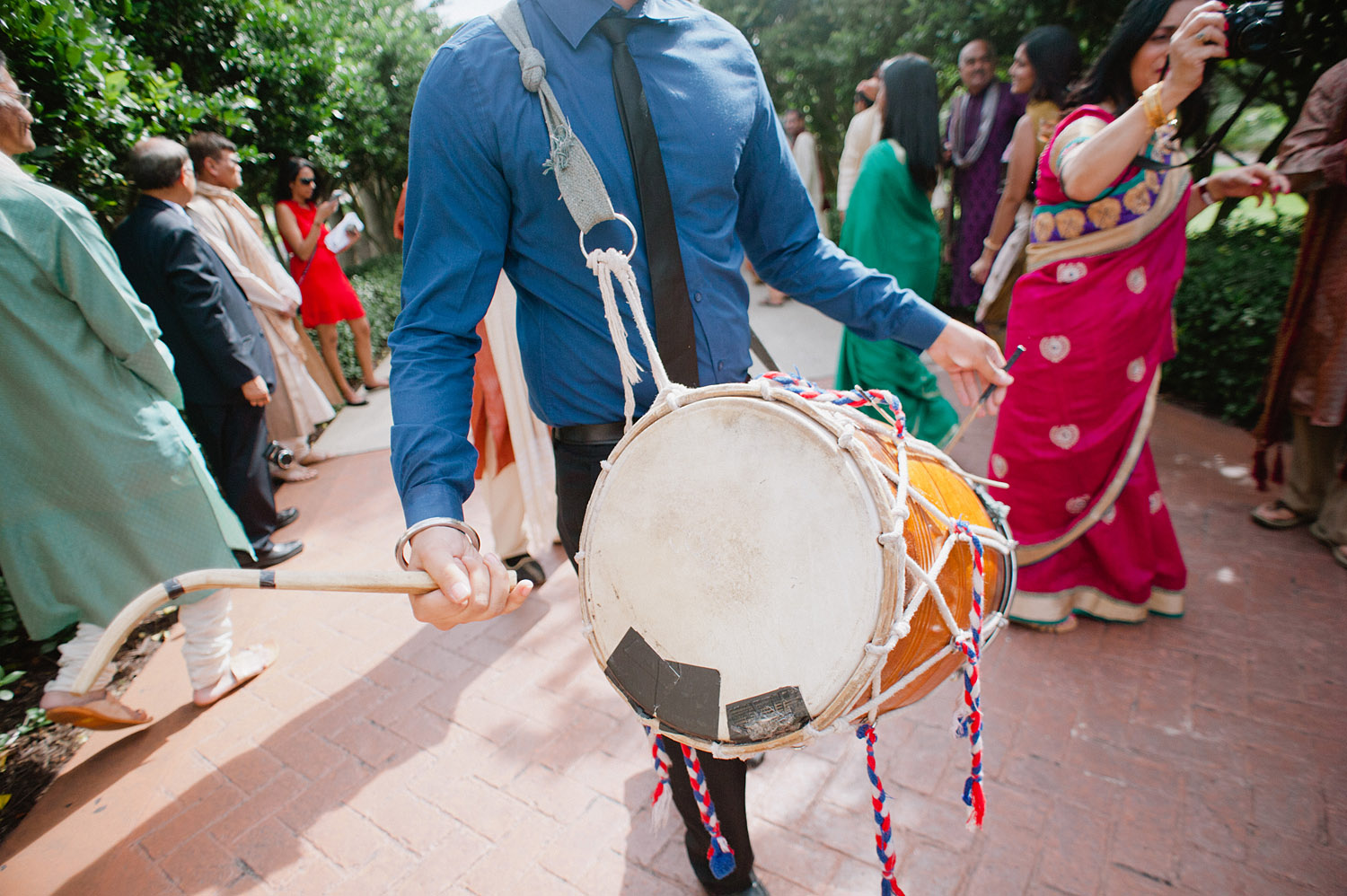 drummer at this hindu wedding ceremony in Palm Coast Florida where Destination wedding photographer Lexia Frank, a top indian wedding photographer, photographs this luxury indian wedding on film - preferring the soft skin tones and vibrant colors of film for indian weddings