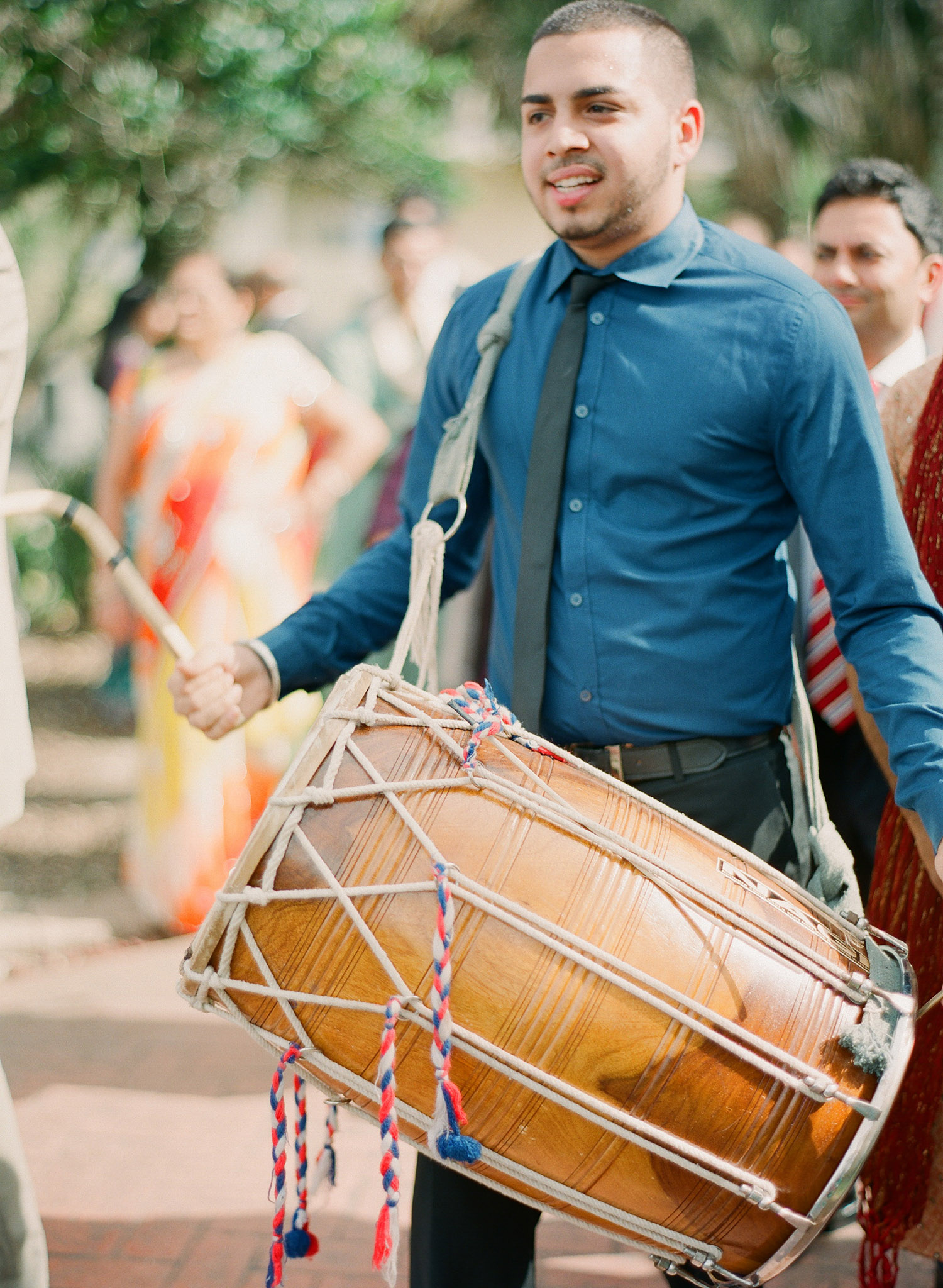 drummer creates a beat for the groom's parade at this Indian Wedding in Florida photographed by Destination Wedding Photographer, LExia Frank - a top indian wedding photographer - who shoots film for luxury indian weddings preferring the soft skin tones and vibrant colors for indian weddings in india and worldwide