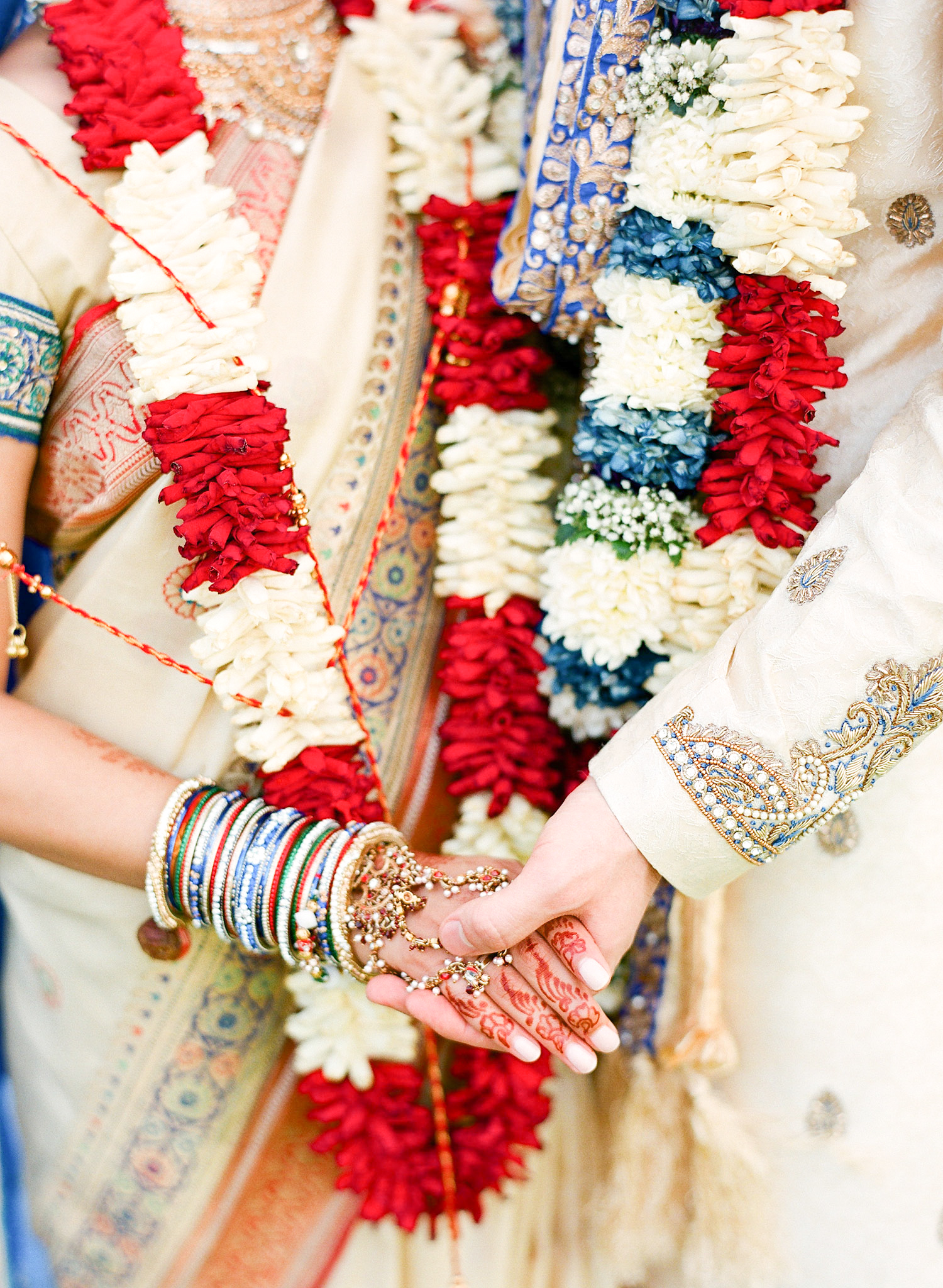 hindu bride and groom hold hands during their Indian Wedding in Florida photographed by Destination Wedding Photographer, LExia Frank - a top indian wedding photographer - who shoots film for luxury indian weddings preferring the soft skin tones and vibrant colors for indian weddings in india and worldwide
