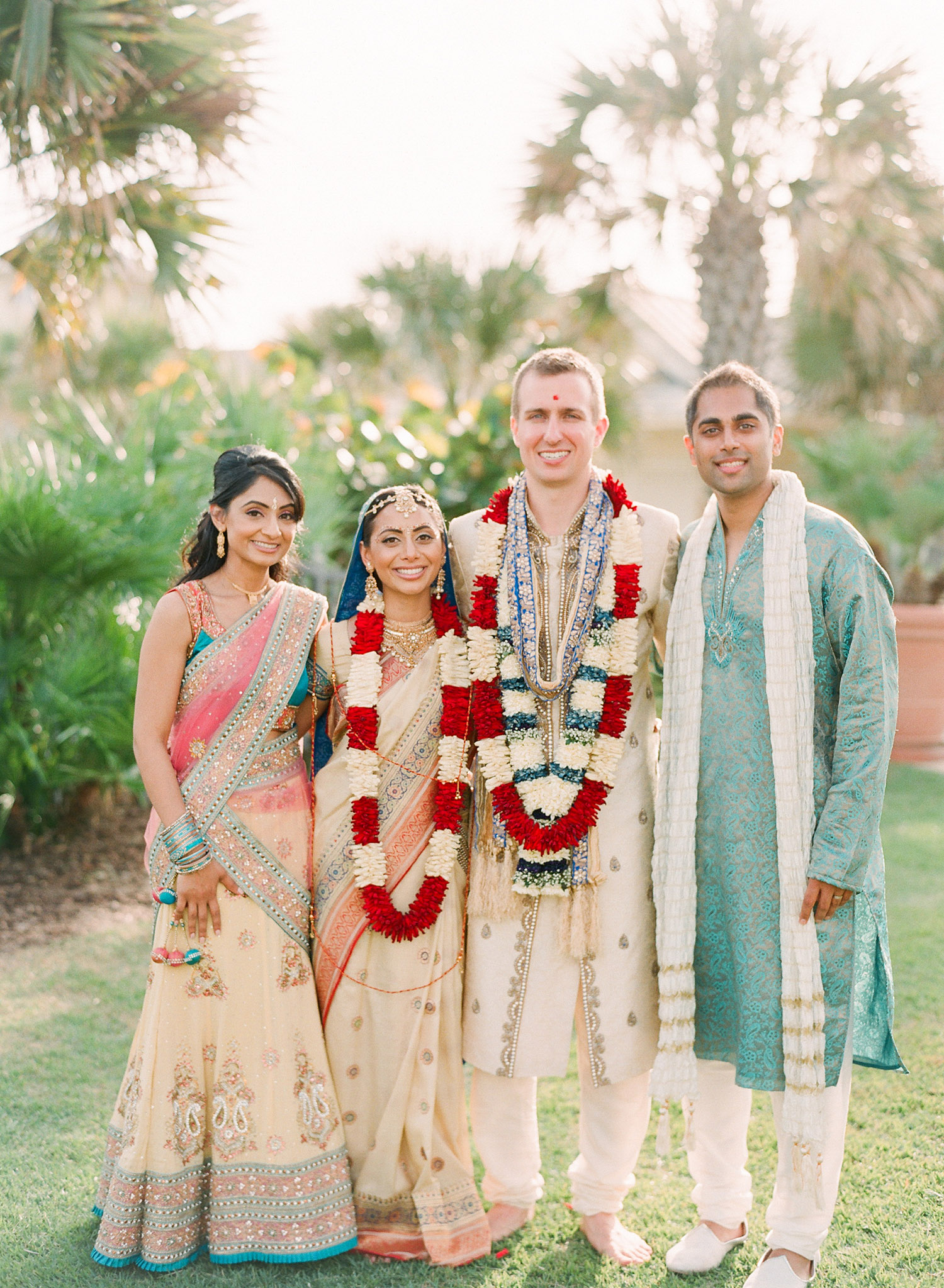 family formal photos after this Indian Wedding in Florida photographed by Destination Wedding Photographer, LExia Frank - a top indian wedding photographer - who shoots film for luxury indian weddings preferring the soft skin tones and vibrant colors for indian weddings in india and worldwide