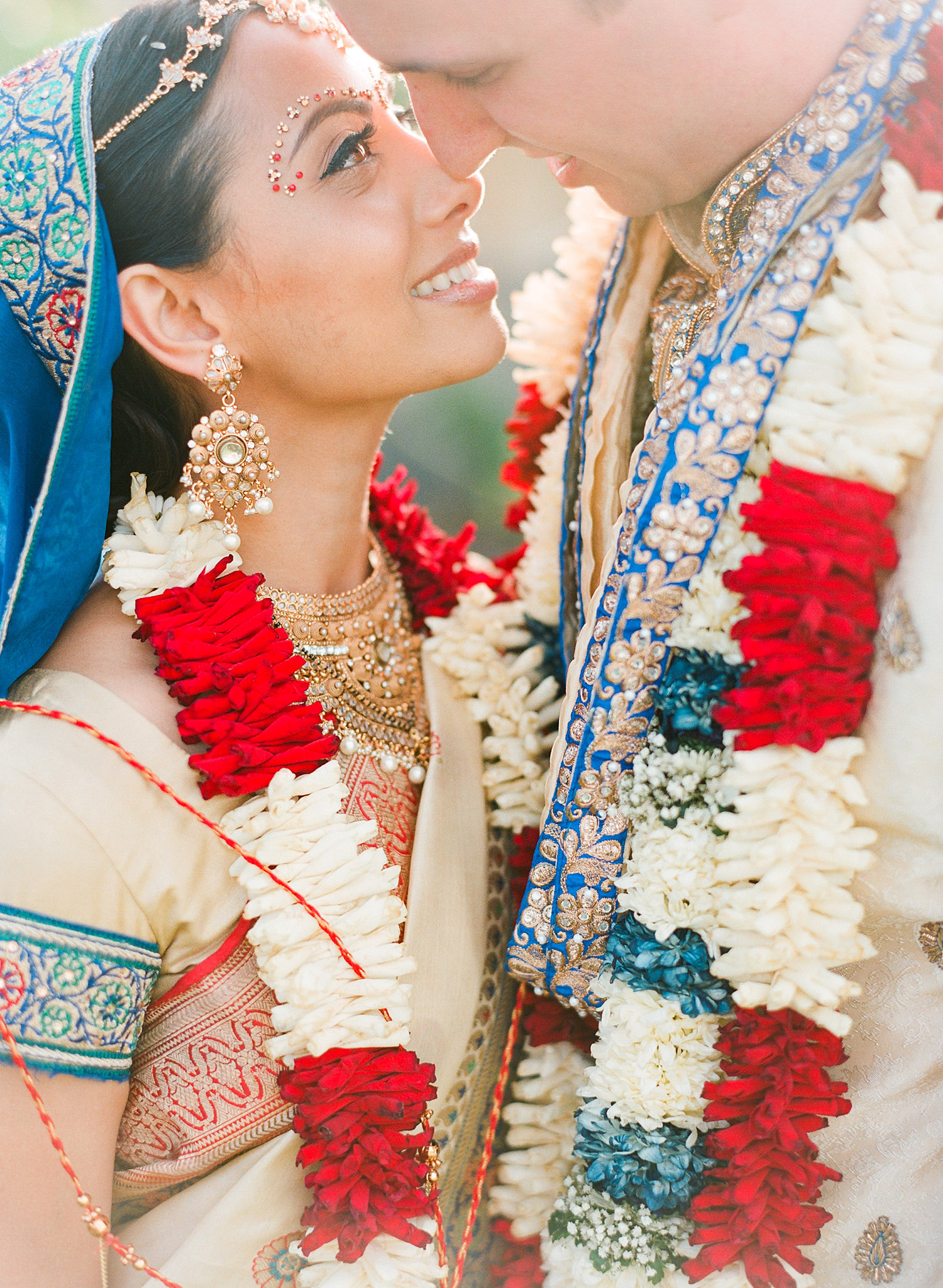 bride and groom after the ceremony at this Indian Wedding in Florida photographed by Destination Wedding Photographer, LExia Frank - a top indian wedding photographer - who shoots film for luxury indian weddings preferring the soft skin tones and vibrant colors for indian weddings in india and worldwide
