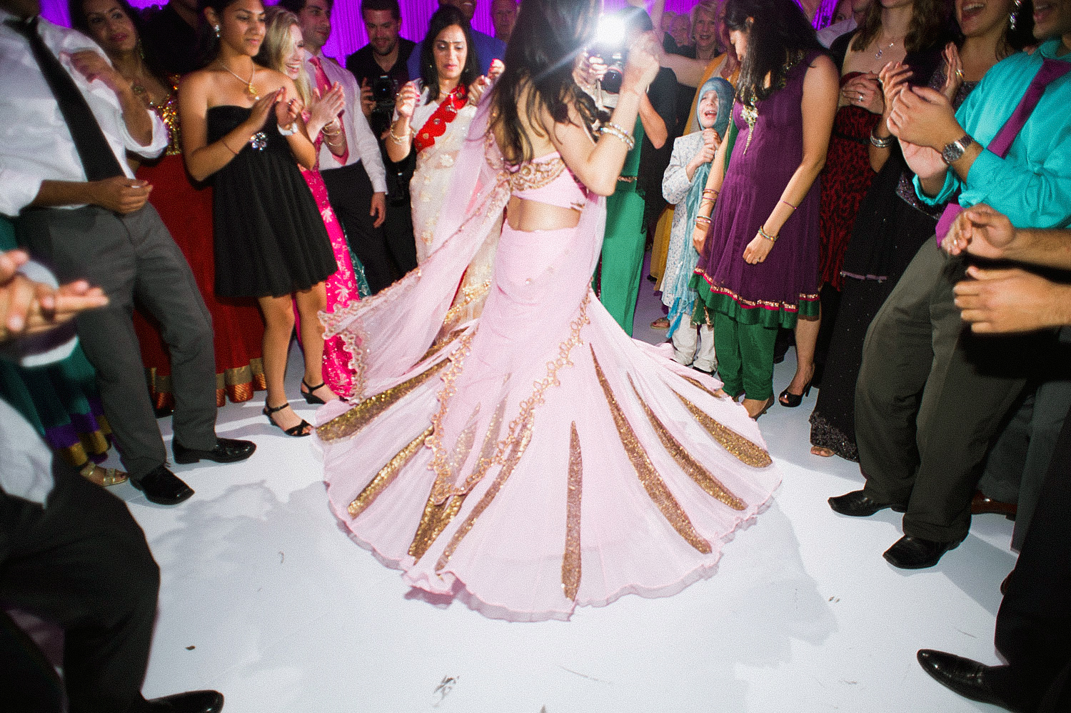 indian bride wears a pink and gold wedding lengha for her indian wedding in florida on the beach in palm coast florida as Destination Wedding Photographer Lexia Frank - an award winning indian wedding photographer - photographs her indian wedding on film, as she is a fine art wedding film photographer for destination weddings and luxury weddings worldwide. vizcaya miami wedding, hammock beach resort wedding