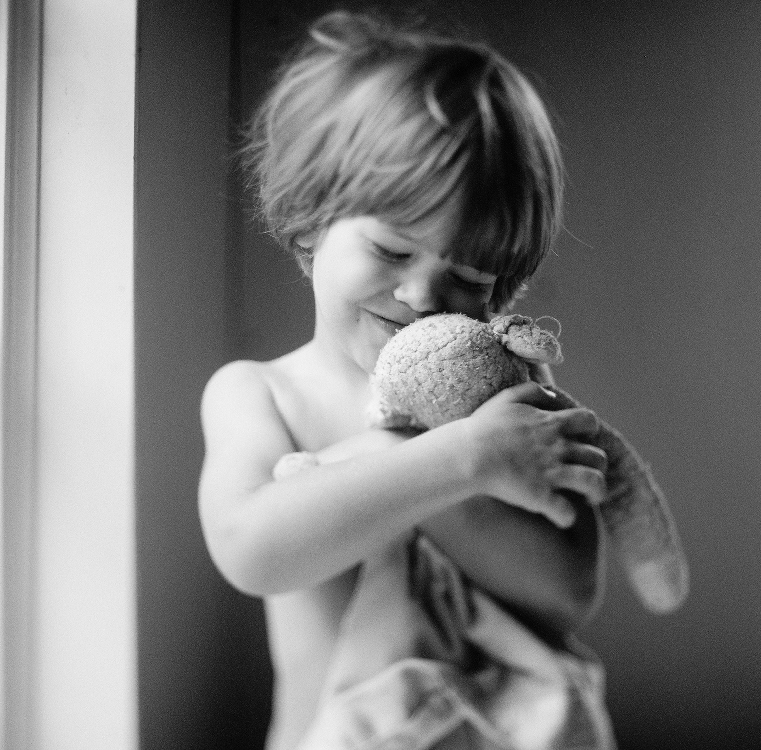 little boy hugs his lovie during a lifestyle shoot with Portland Oregon Lifestyle Family Photographer - lexia Frank - a film photographer in portland oregon
