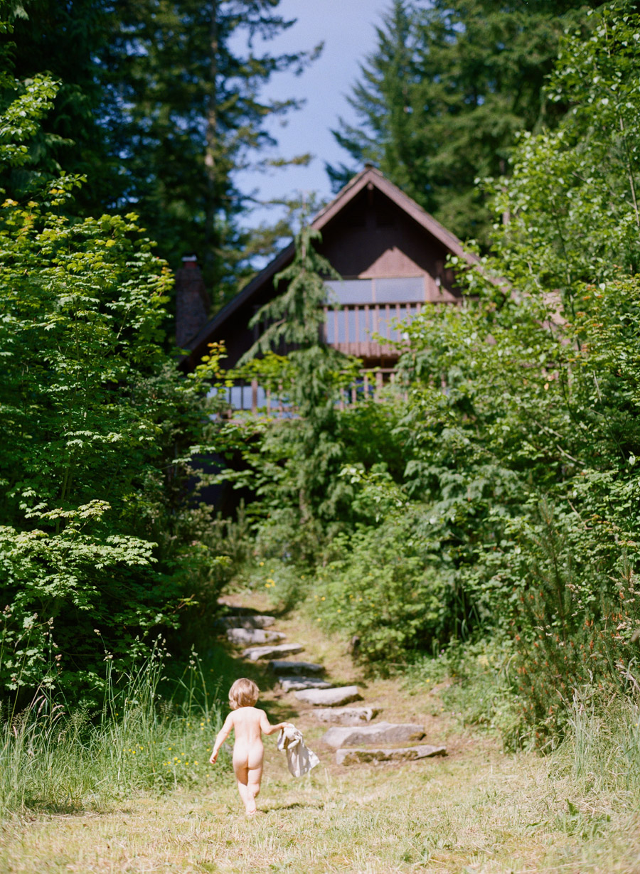 a little boy walks back to the cabin in portland oregon during this lifestyle family session by Portland Oregon Family Photographer - lexia frank - a film photographer in Portland Oregon