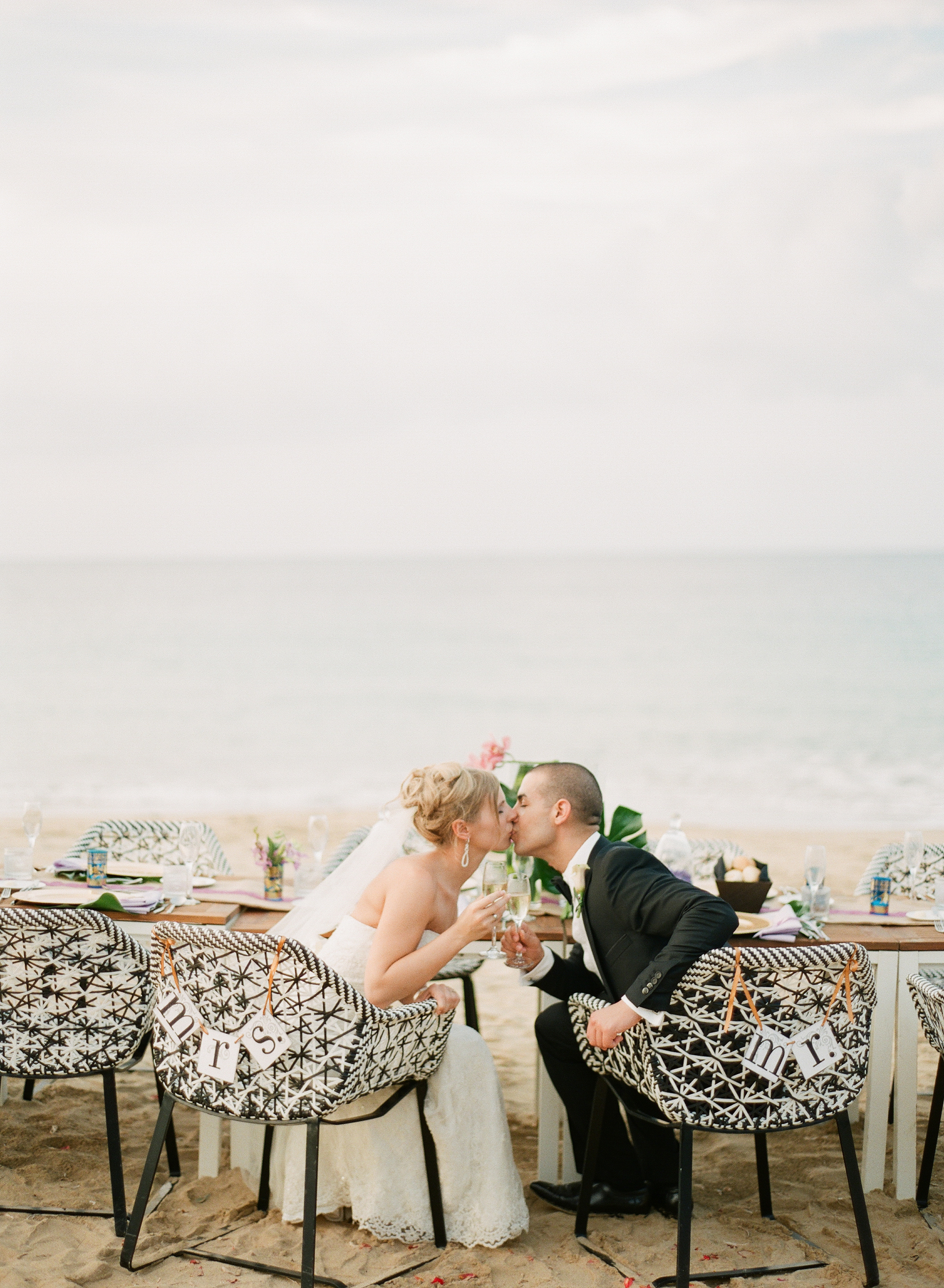 Destination wedding photographer, Lexia Frank, photographs this modern wedding at the W hotel in Vieques Island, where the bride chose to have the wedding reception on the beach with modern chairs and decor for her wedding. she is a film photographer specializing in destination weddings and luxury weddings worldwide.