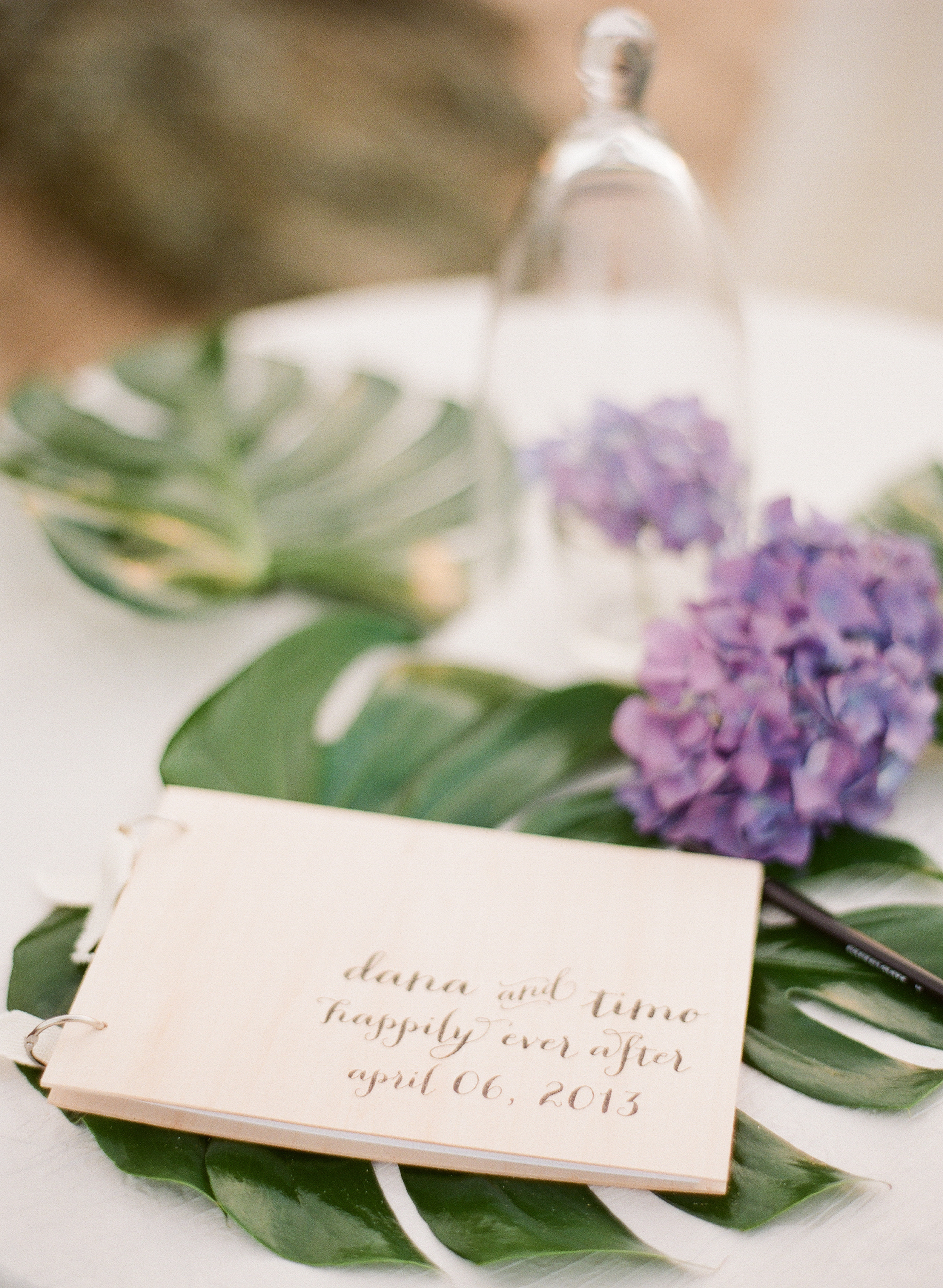 a handmade and hand-lettered wooden guestbook is pictured here at this wedding that Destination Wedding Photographer, Lexia Frank, photographed at the W hotel in Vieques Island Puerto Rico. Lexia is a film photographer specializing in destiantion weddings and luxury weddings worldwide.