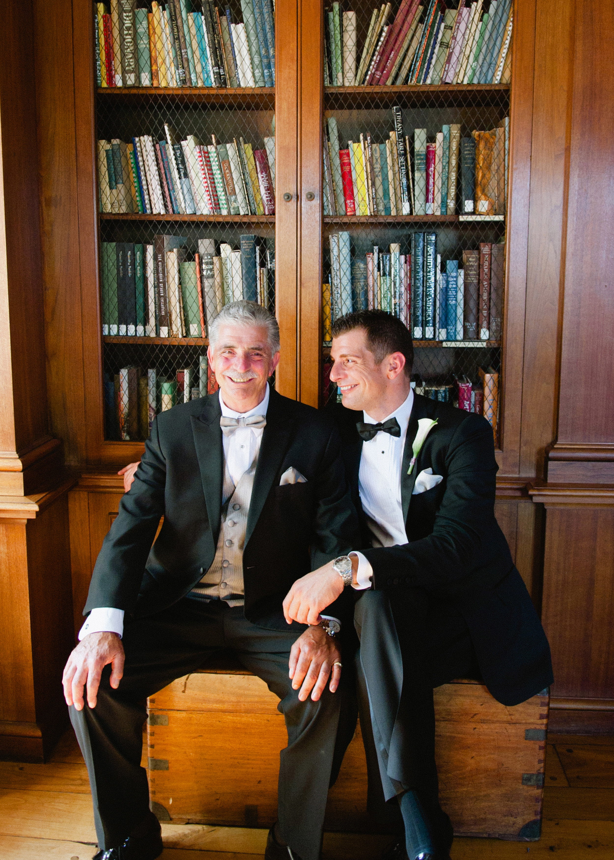 Destination Wedding Photographer Lexia Frank is a film photographer on the west coast specializing in luxury weddings and fine art film photography. In this article she writes a letter to the groom, and talks about the groom's role in photography. groom poses with his father during his villa terrace wedding in milwaukee wisconsin wedding photographer www.lexiafrank.com