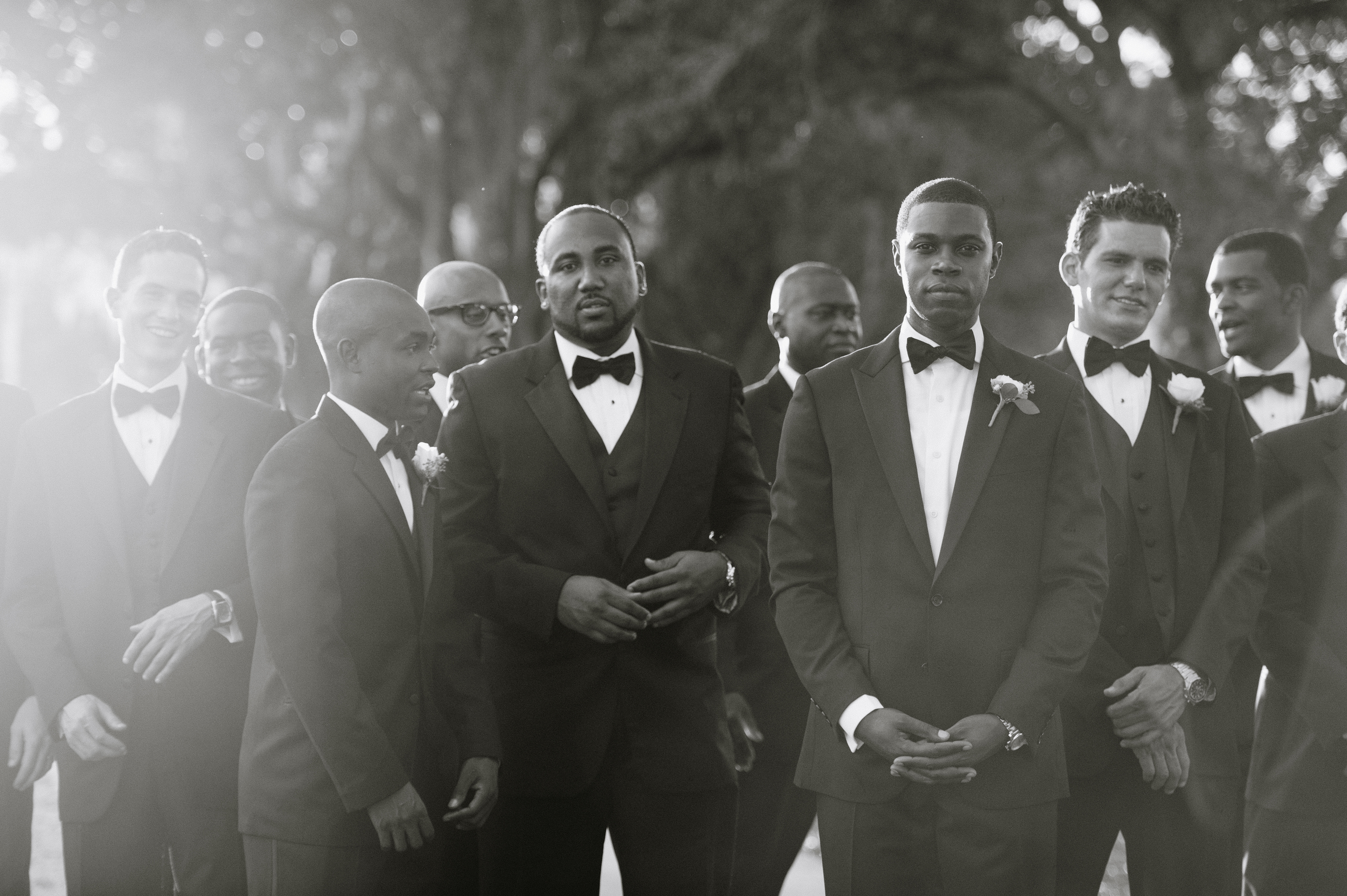 Destination Wedding Photographer Lexia Frank is a film photographer on the west coast specializing in luxury weddings and fine art film photography. In this article she writes a letter to the groom, and talks about the groom's role in photography. groomsmen pose during this tampa wedding. www.lexiafrank.com
