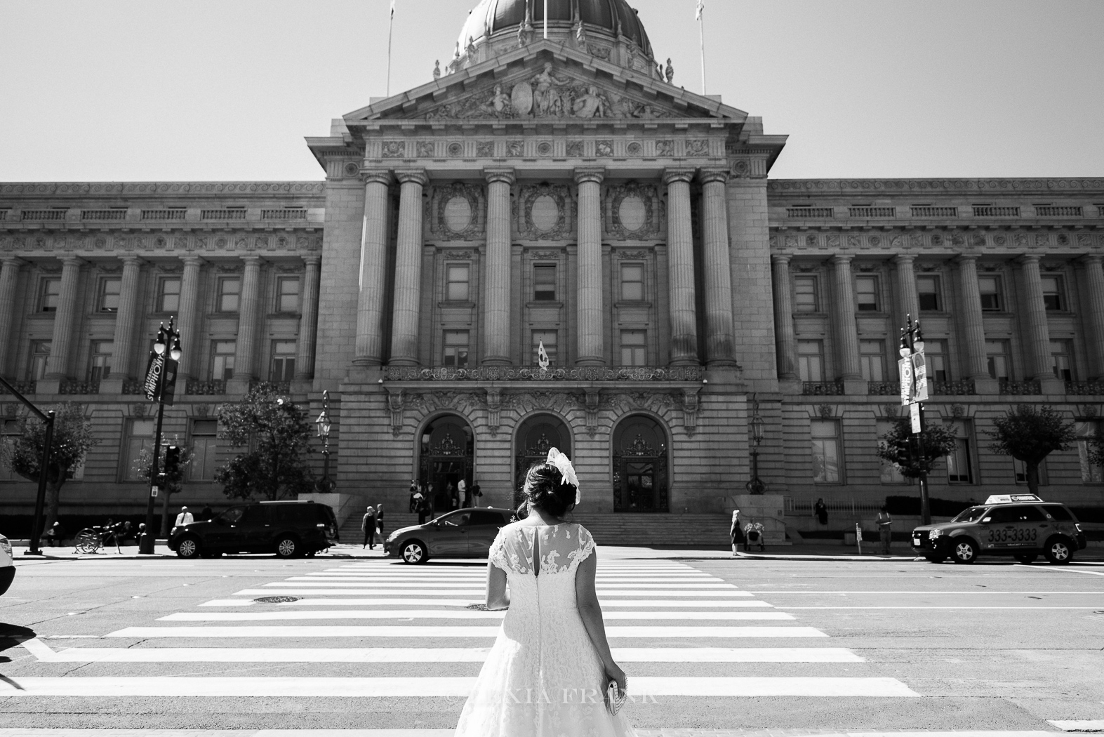 Destination Wedding Photographer Lexia Frank - a portland Oregon fine art film photographer - photographs this San Francisco City Hall wedding in san francisco as the bride heads to the coutrthouse www.lexiafrank.com
